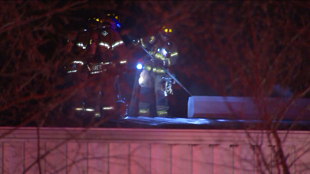 Firefighters at FleetPride after a garage caught on fire early Thursday morning.
