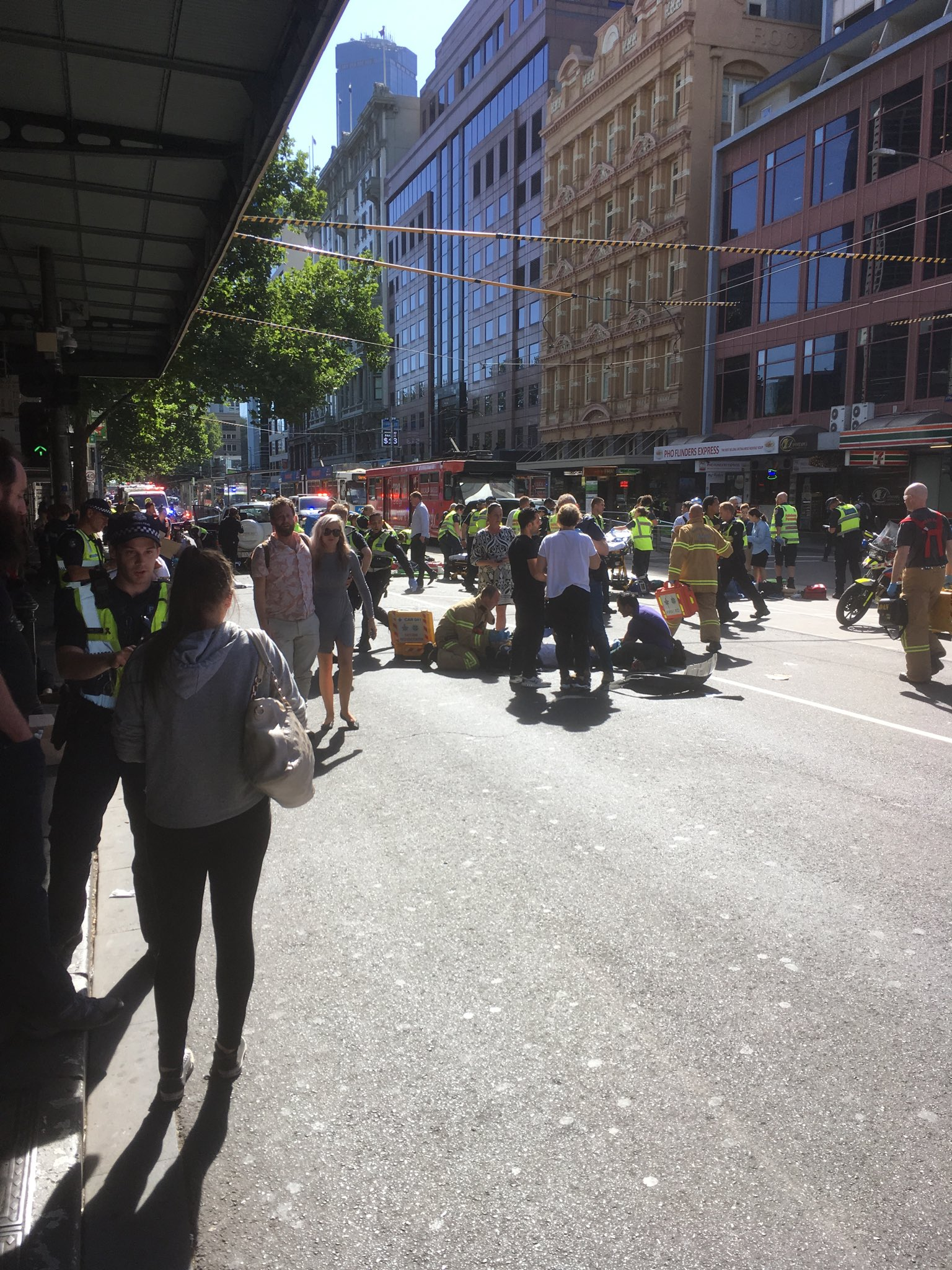 "<div class=""meta image-caption""><div class=""origin-logo origin-image none""><span>none</span></div><span class=""caption-text"">''Scene on Flinders St. White SUV has gone through pedestrians and crashed into tram stop,'' wrote a reporter for 9 News Melbourne.</span></div>"