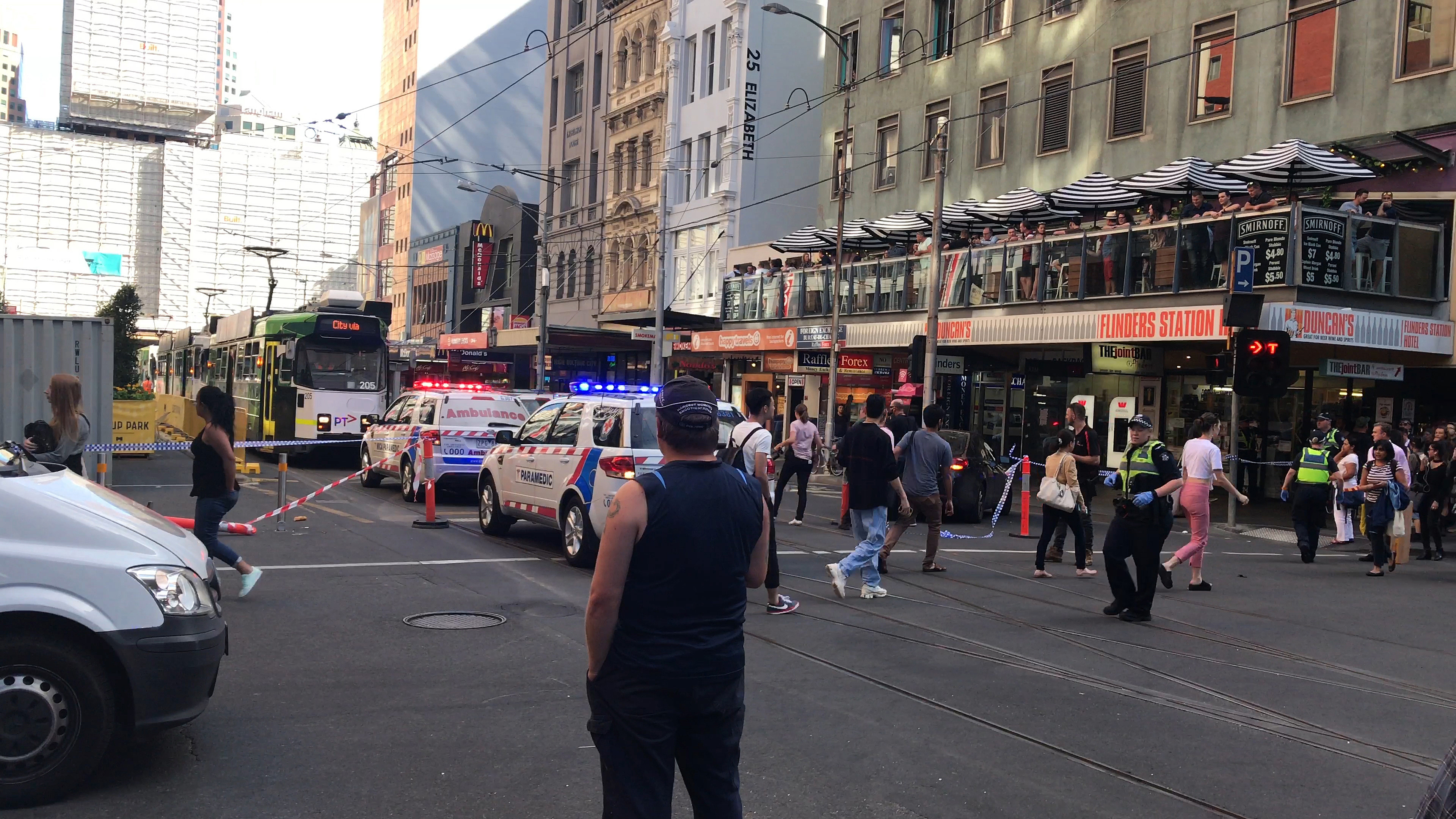 <div class='meta'><div class='origin-logo' data-origin='none'></div><span class='caption-text' data-credit='Kaitlyn Offer/AAP Image via AP'>Pedestrians walk past as police and emergency services attend the scene of an incident involving a vehicle and pedestrians in Melbourne, Thursday, Dec. 21, 2017.</span></div>
