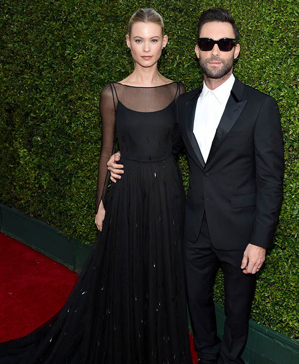 "<div class=""meta image-caption""><div class=""origin-logo origin-image ""><span></span></div><span class=""caption-text"">Behati Prinsloo and Adam Levine (John Shearer/Invision for the Television Academy/AP Images)</span></div>"