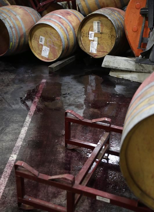 "<div class=""meta image-caption""><div class=""origin-logo origin-image ""><span></span></div><span class=""caption-text"">Wine leaks from some of the hundreds of earthquake damaged wine barrels at the Kieu Hoang Winery Monday, Aug. 25, 2014, in Napa, Calif.  (AP Photo/Eric Risberg)</span></div>"