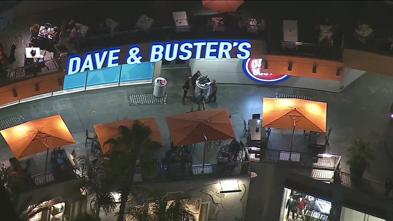 Los Angeles police officers respond to an incident involving Justin Bieber at Dave & Busters in Hollywood on Monday, Aug. 25, 2014.