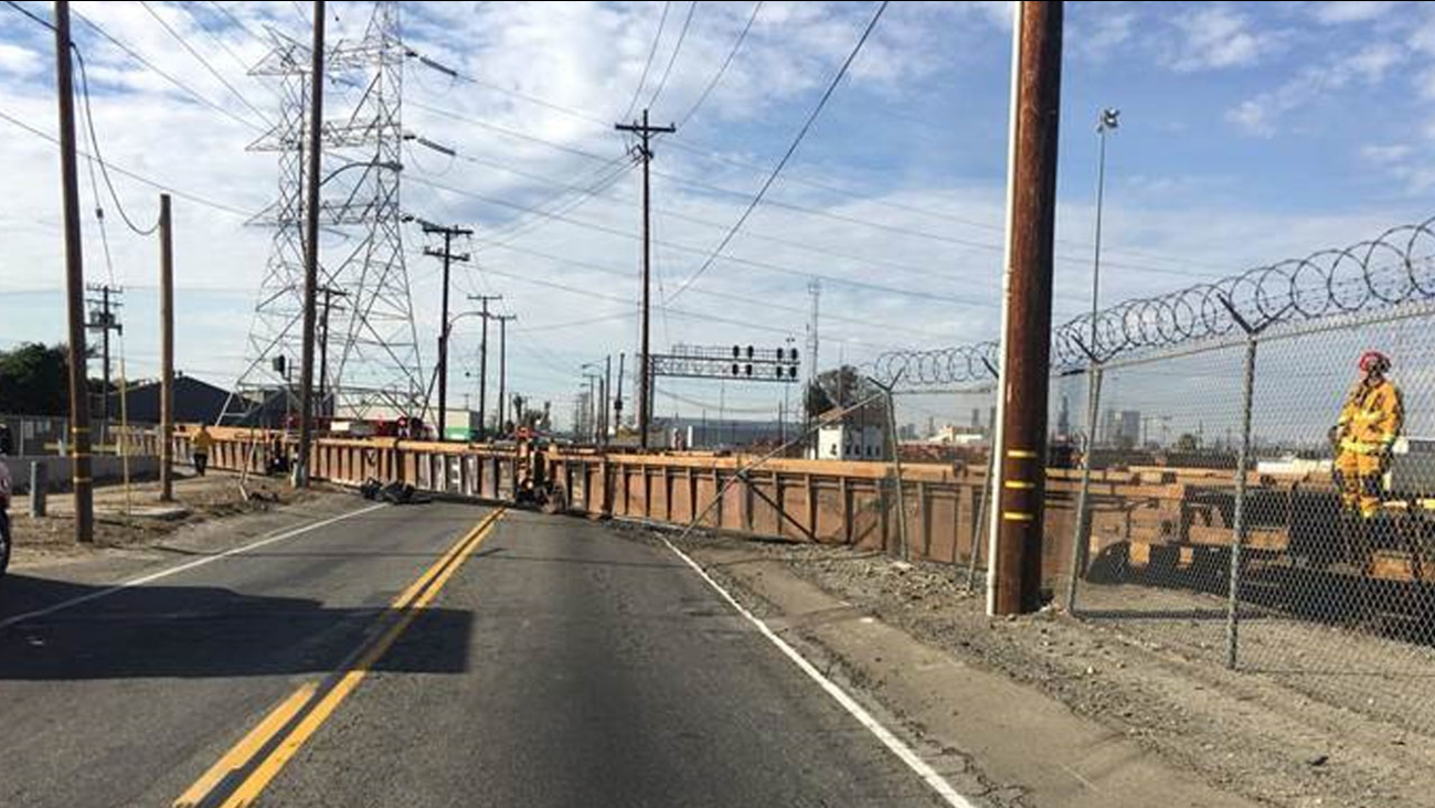 Vernon police tweeted a photo of the train laying on its side, blocking the roadway on 26th Street between Sierra Pine and Indiana.