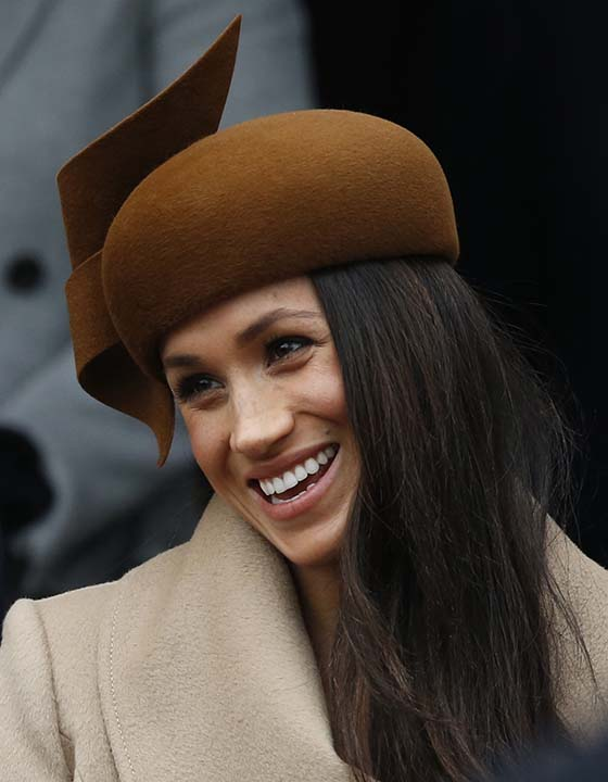 "<div class=""meta image-caption""><div class=""origin-logo origin-image ap""><span>AP</span></div><span class=""caption-text"">Meghan Markle fiancee of Prince Harry smiles as she waits for the Queen to leave by car following the traditional Christmas Day church service at St. Mary Magdalene Church. (AP Photo/Alastair Grant)</span></div>"