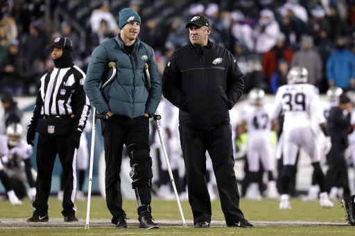 "<div class=""meta image-caption""><div class=""origin-logo origin-image ap""><span>AP</span></div><span class=""caption-text"">Philadelphia Eagles' Carson Wentz walks with head coach Doug Pederson before an NFL football game against the Oakland Raiders, Monday, Dec. 25, 2017, in Philadelphia. (AP Photo/Michael Perez)</span></div>"