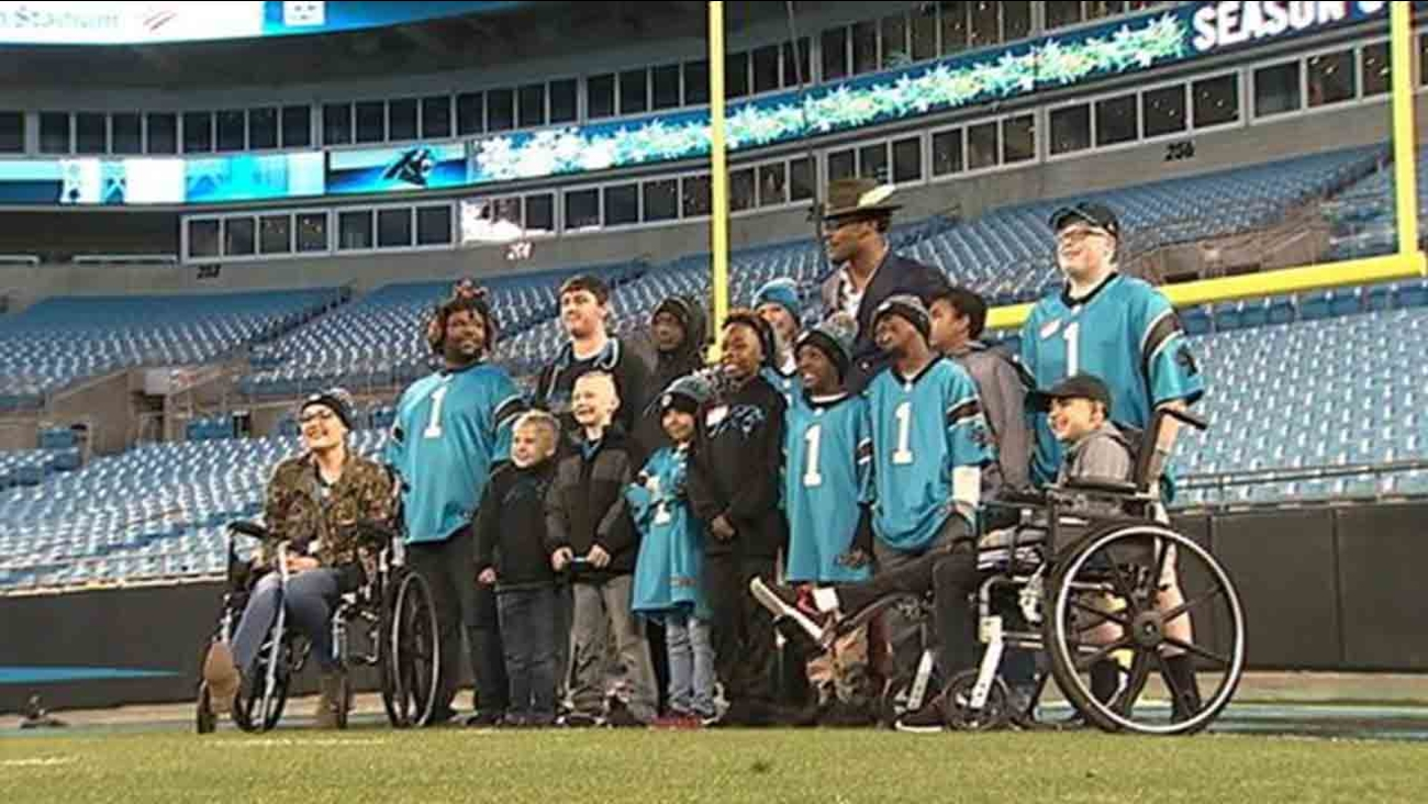 Cam poses with the kids