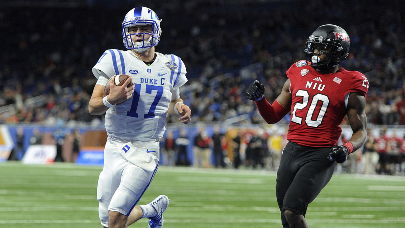 Duke quarterback Daniel Jones runs for a touchdown past Northern Illinois safety Mycial Allen during the first quarter of the Quick Lane Bowl on Tuesday in Detroit.