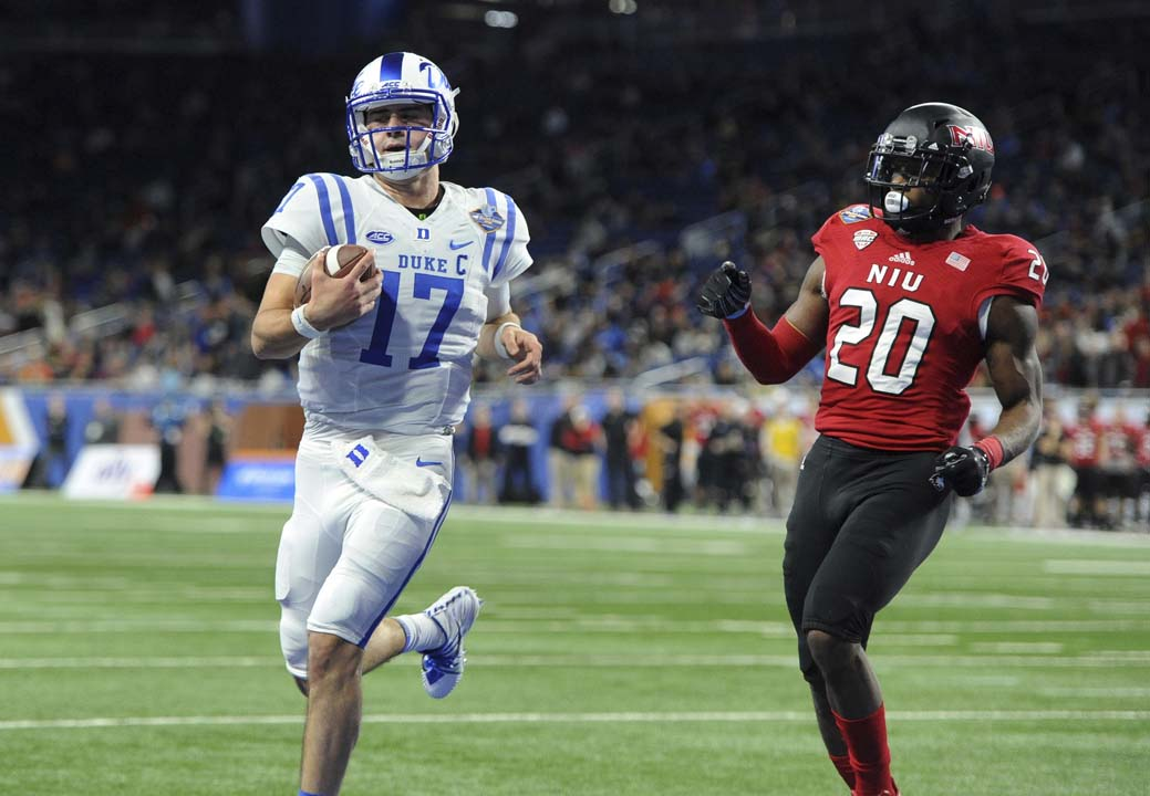 <div class='meta'><div class='origin-logo' data-origin='AP'></div><span class='caption-text' data-credit='Jose Juarez'>Duke quarterback Daniel Jones runs for a touchdown past Northern Illinois safety Mycial Allen during the first quarter of the Quick Lane Bowl.</span></div>
