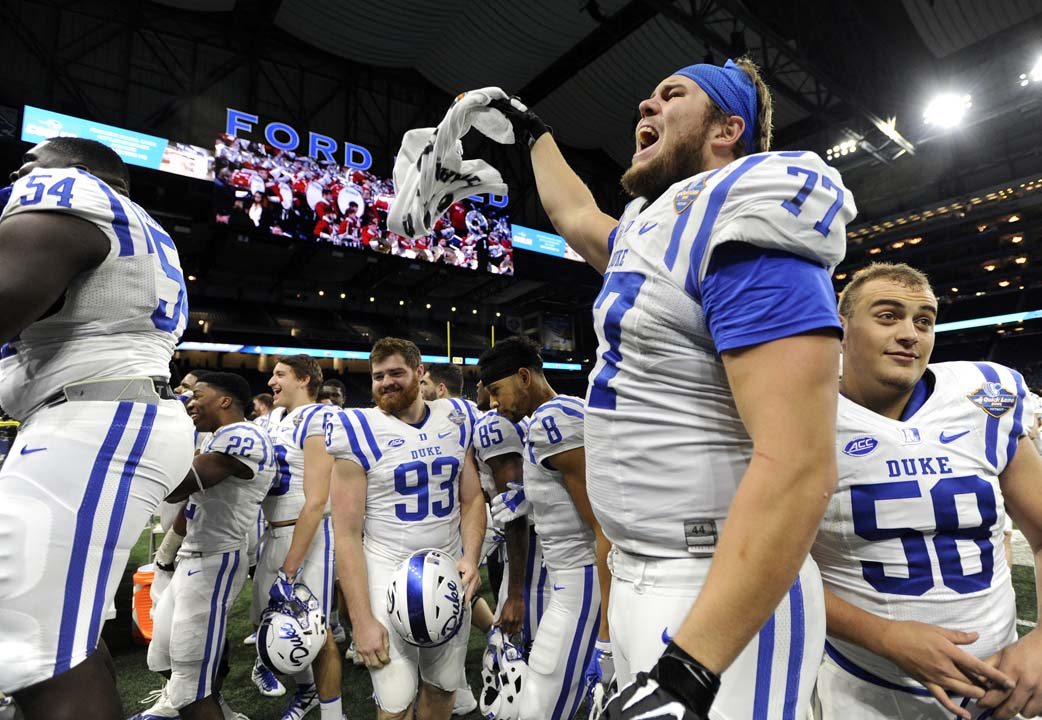 <div class='meta'><div class='origin-logo' data-origin='AP'></div><span class='caption-text' data-credit='Jose Juarez'>Duke offensive tackle Robert Kraeling (77) cheers on the crowd in the final minute against Northern Illinois.</span></div>