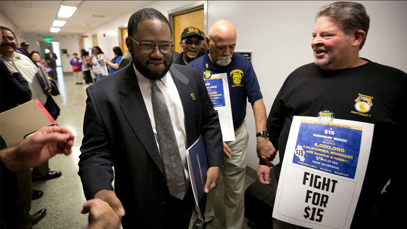 Assemblyman Sebastian Ridley-Thomas, D-Los Angeles, center, is greeted by supporters as he walks to the Assembly Thursday, March 31, 2016, in Sacramento, California.