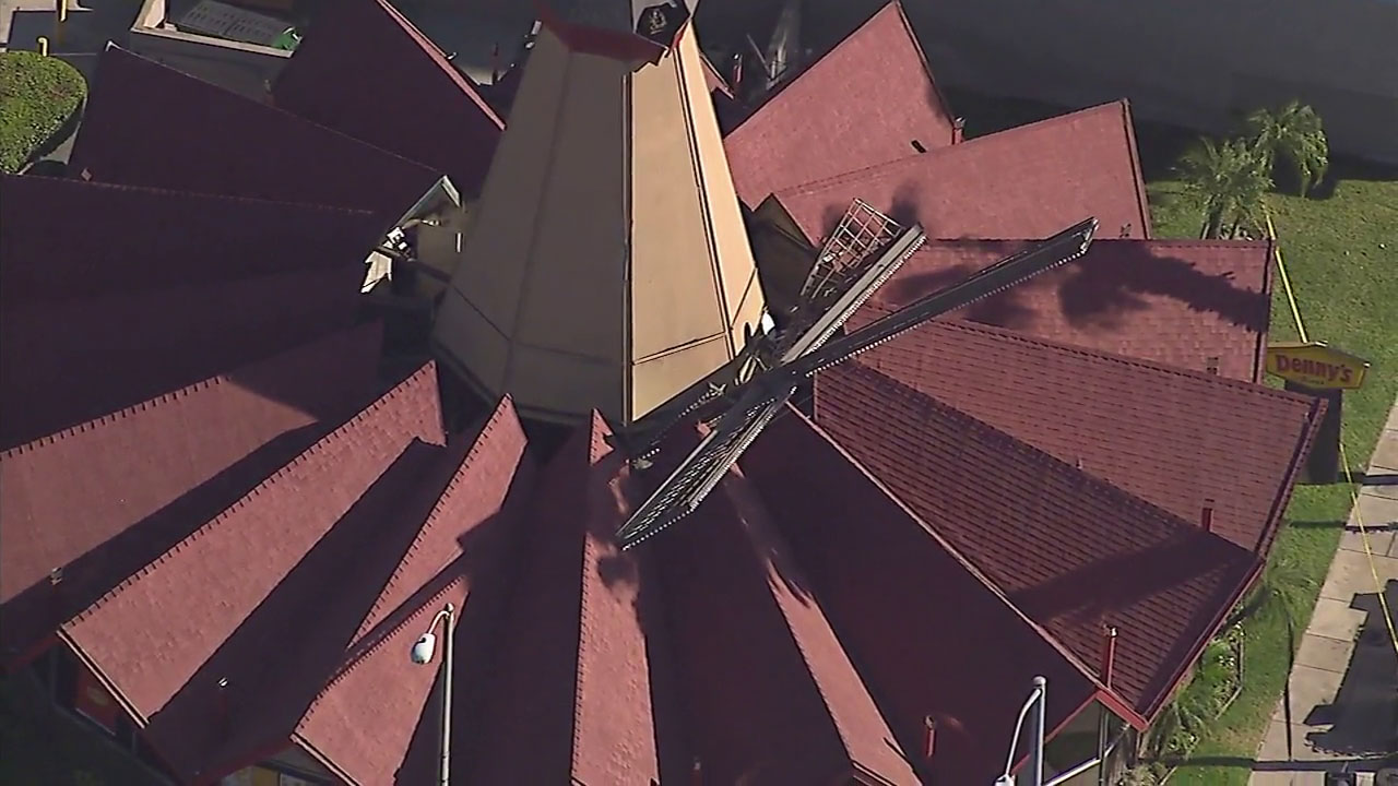 A large windmill blade that sits atop the Denny's on E. Huntington Drive in Arcadia broke off Friday and fell onto the restaurant's roof.