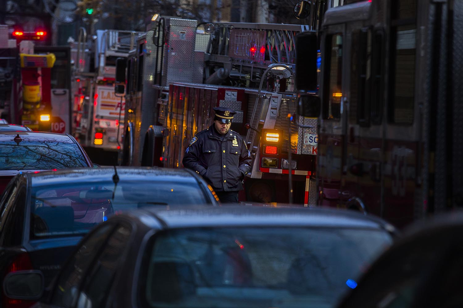 """<div class=""""meta image-caption""""><div class=""""origin-logo origin-image ap""""><span>AP</span></div><span class=""""caption-text"""">A police officer walks in between firefighters trucks Friday, Dec. 29, 2017, in the Bronx. (AP Photo/Andres Kudacki)</span></div>"""