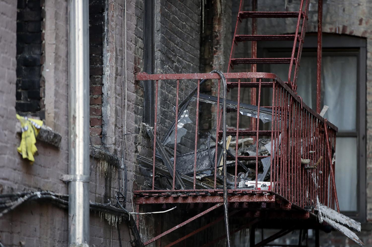 <div class='meta'><div class='origin-logo' data-origin='AP'></div><span class='caption-text' data-credit='AP Photo/Julio Cortez'>Charred items sit on the fire escape of an apartment building where more than 10 people died in a fire a day earlier in the Bronx borough of New York, Friday, Dec. 29, 2017.</span></div>