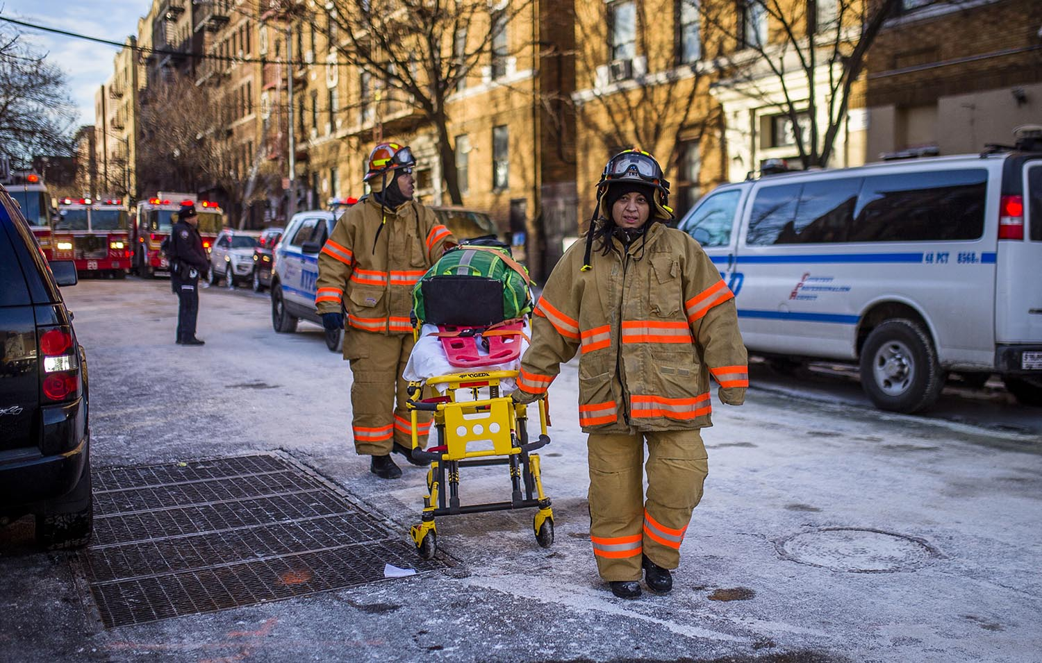 """<div class=""""meta image-caption""""><div class=""""origin-logo origin-image ap""""><span>AP</span></div><span class=""""caption-text"""">Police stand guard as paramedics leave the scene near the building Friday, Dec. 29, 2017, where more than 10 people died in a fire on Thursday in the Bronx. (AP Photo/Andres Kudacki)</span></div>"""