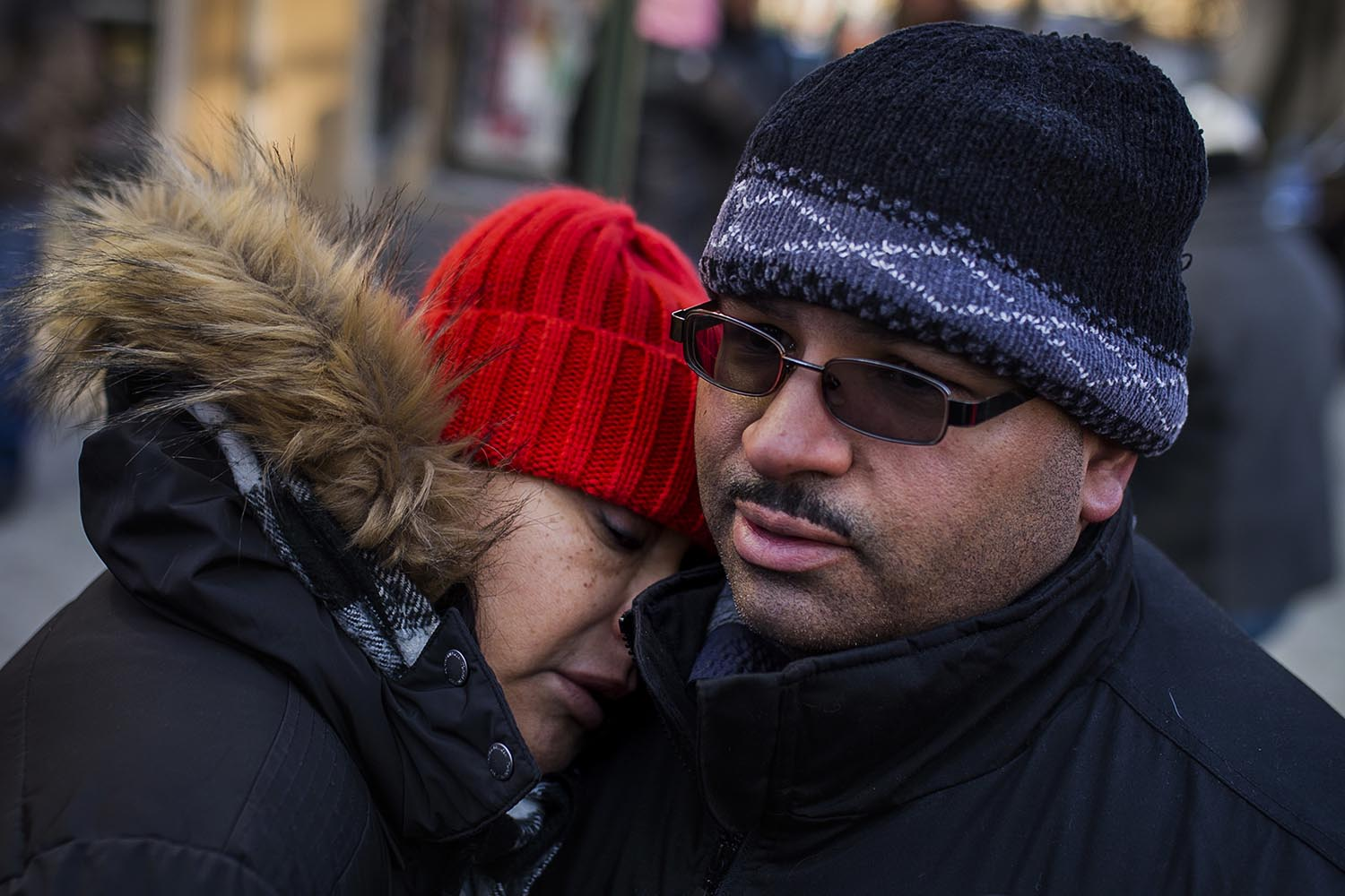 <div class='meta'><div class='origin-logo' data-origin='AP'></div><span class='caption-text' data-credit='AP Photo/Andres Kudacki'>Betty Rodriguez and her husband Joel Rodriguez, residents of the building where more than 10 people died in a fire on Thursday, react as they talk to the media on Dec. 29, 2017.</span></div>