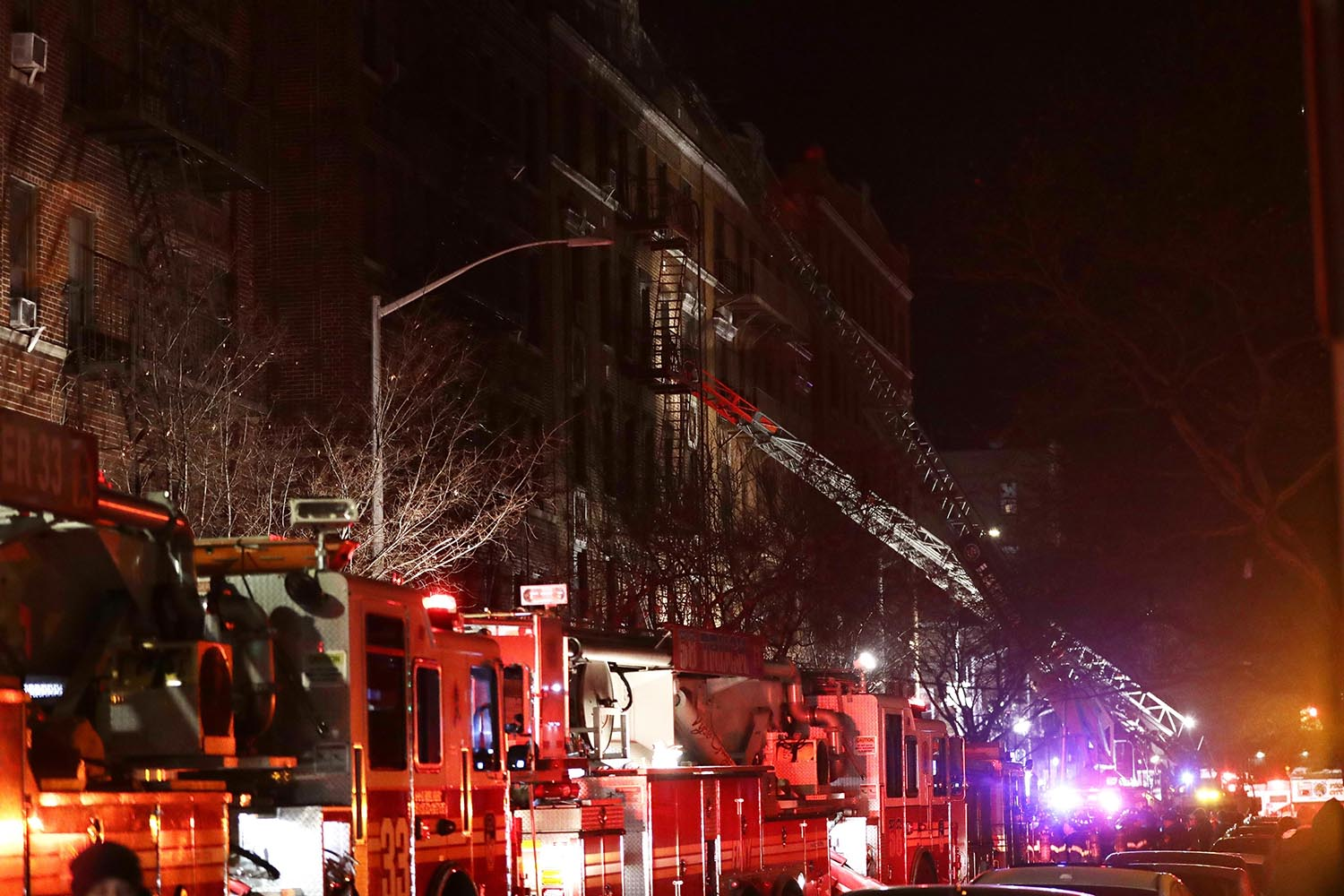 <div class='meta'><div class='origin-logo' data-origin='AP'></div><span class='caption-text' data-credit='AP Photo/Frank Franklin II'>Firefighters respond to a building fire Thursday, Dec. 28, 2017, in the Bronx borough of New York.</span></div>
