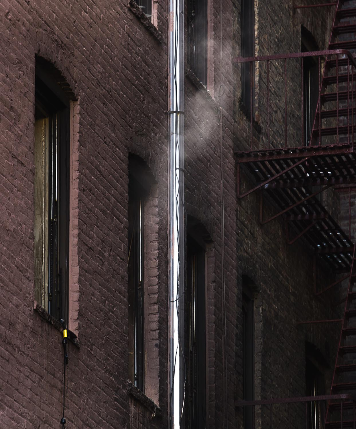 """<div class=""""meta image-caption""""><div class=""""origin-logo origin-image ap""""><span>AP</span></div><span class=""""caption-text"""">Smoke rises from a window of a burned apartment of the building where twelve people died in a fire on Thursday, on Friday, Dec. 29, 2017, in the Bronx borough of New York. (AP Photo/Andres Kudacki)</span></div>"""