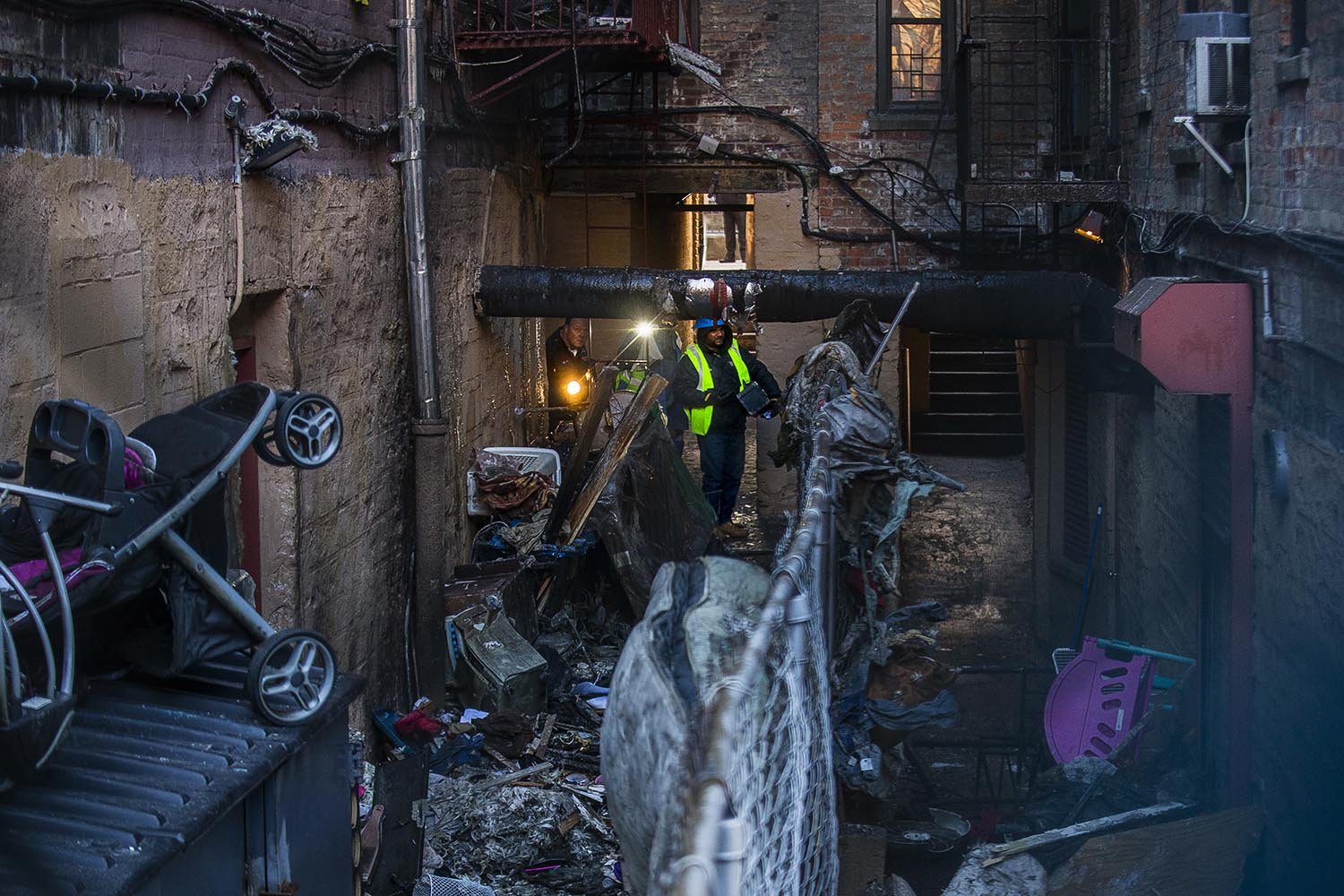 """<div class=""""meta image-caption""""><div class=""""origin-logo origin-image ap""""><span>AP</span></div><span class=""""caption-text"""">Police and workers inspect the building Friday, Dec. 29, 2017, where more than 10 people died in a fire in the Bronx borough of New York. (AP Photo/Andres Kudacki)</span></div>"""