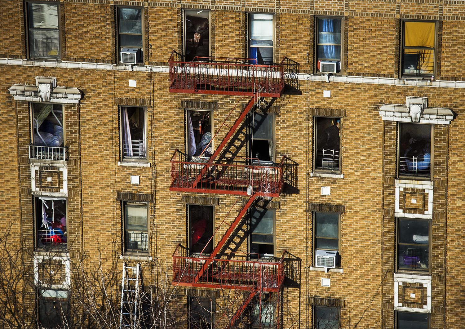 """<div class=""""meta image-caption""""><div class=""""origin-logo origin-image ap""""><span>AP</span></div><span class=""""caption-text"""">A firefighter ladder lay on the wall as furniture is seen through the broken windows of a building Friday, Dec. 29, 2017. (AP Photo/Andres Kudacki)</span></div>"""
