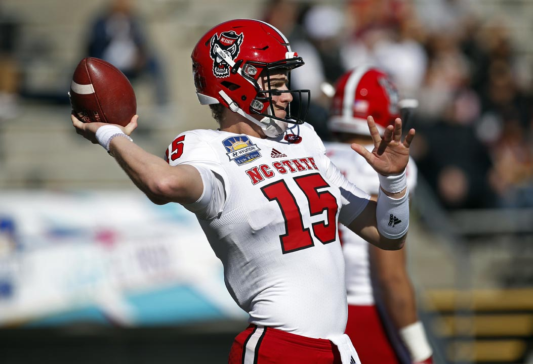 <div class='meta'><div class='origin-logo' data-origin='AP'></div><span class='caption-text' data-credit='Andres Leighton'>North Carolina State quarterback Ryan Finley completed 24 of 29 passes for 318 yards and a score in the Sun Bowl.</span></div>