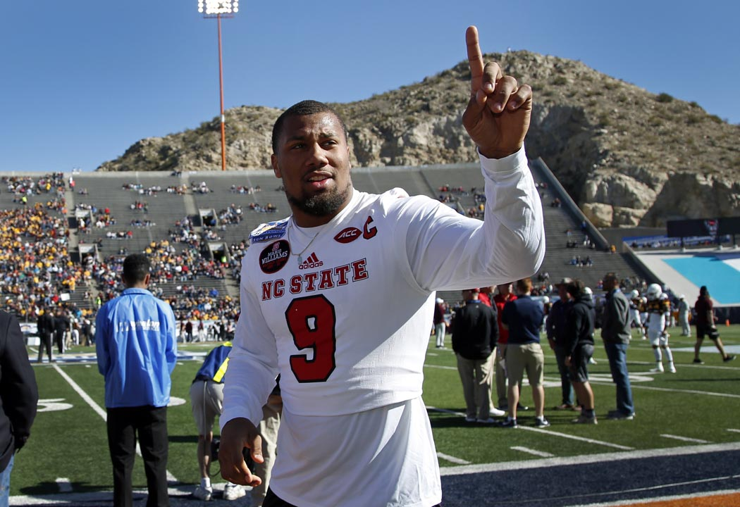<div class='meta'><div class='origin-logo' data-origin='AP'></div><span class='caption-text' data-credit='Andres Leighton'>North Carolina State defensive end Bradley Chubb acknowledges the cheer of fans before the start of the Sun Bowl in El Paso, Texas on Friday.</span></div>