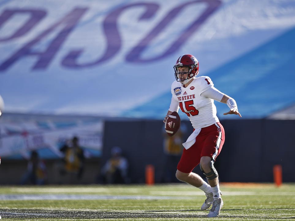 <div class='meta'><div class='origin-logo' data-origin='AP'></div><span class='caption-text' data-credit='Andres Leighton'>NC State quarterback Ryan Finley picks up extra yardage during the first half of the Sun Bowl.</span></div>