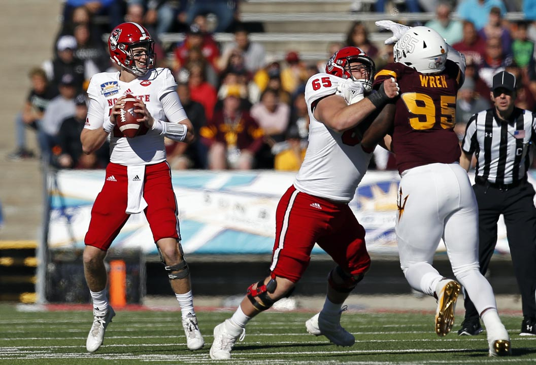 <div class='meta'><div class='origin-logo' data-origin='AP'></div><span class='caption-text' data-credit='Andres Leighton'>Ryan Finley searches for a receiver against Arizona State in El Paso, Texas</span></div>