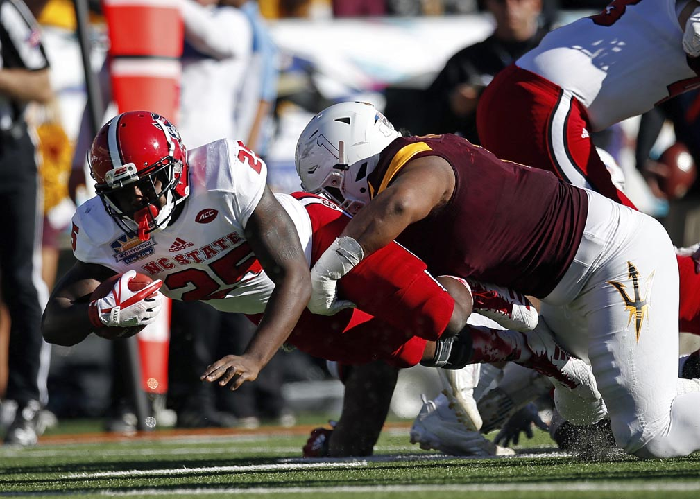 <div class='meta'><div class='origin-logo' data-origin='AP'></div><span class='caption-text' data-credit='Andres Leighton'>North Carolina State running back Reggie Gallaspy ran for a pair of touchdowns and 79 yards on 12 carries.</span></div>