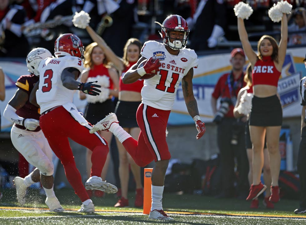 <div class='meta'><div class='origin-logo' data-origin='AP'></div><span class='caption-text' data-credit='Andres Leighton'>North Carolina State wide receiver Jacobi Meyers (11) scores a touchdown against Arizona State.</span></div>