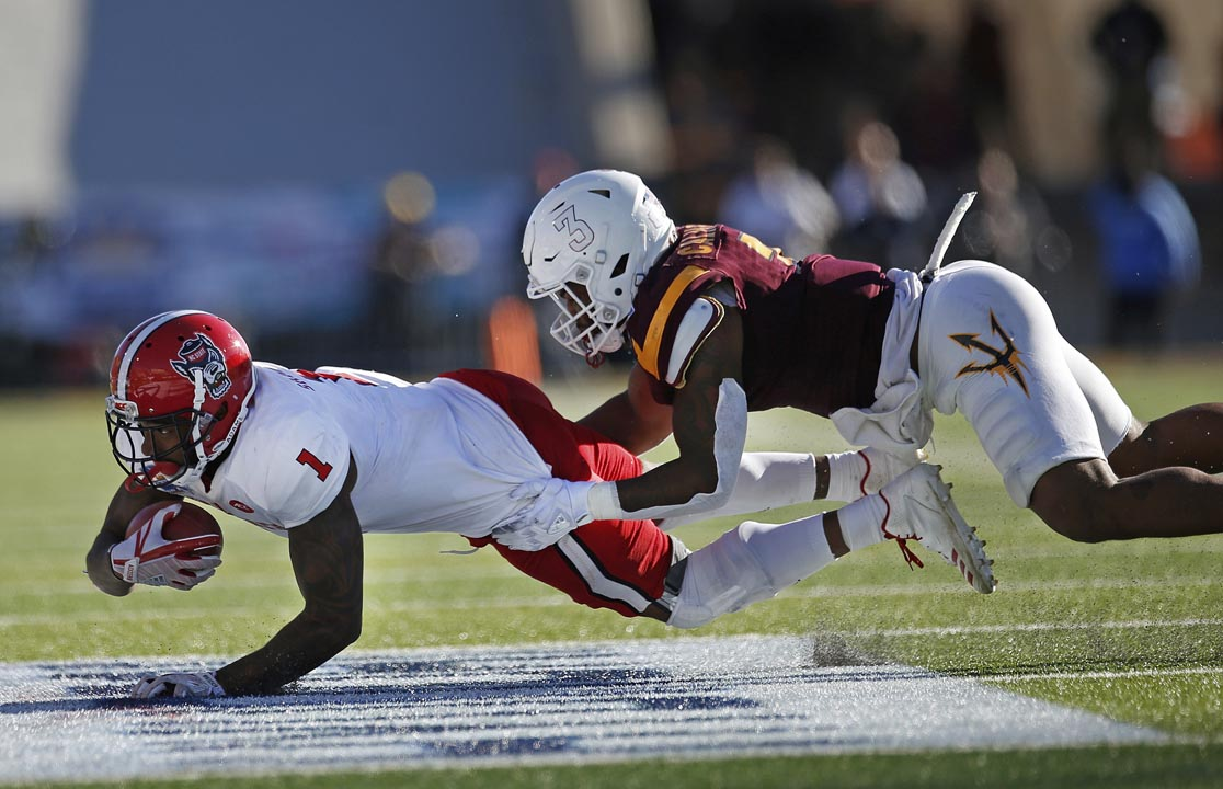 <div class='meta'><div class='origin-logo' data-origin='AP'></div><span class='caption-text' data-credit='Andres Leighton'>N State's Jaylen Samuels had one score and became the Wolfpack's all-time receptions leader in this game.</span></div>