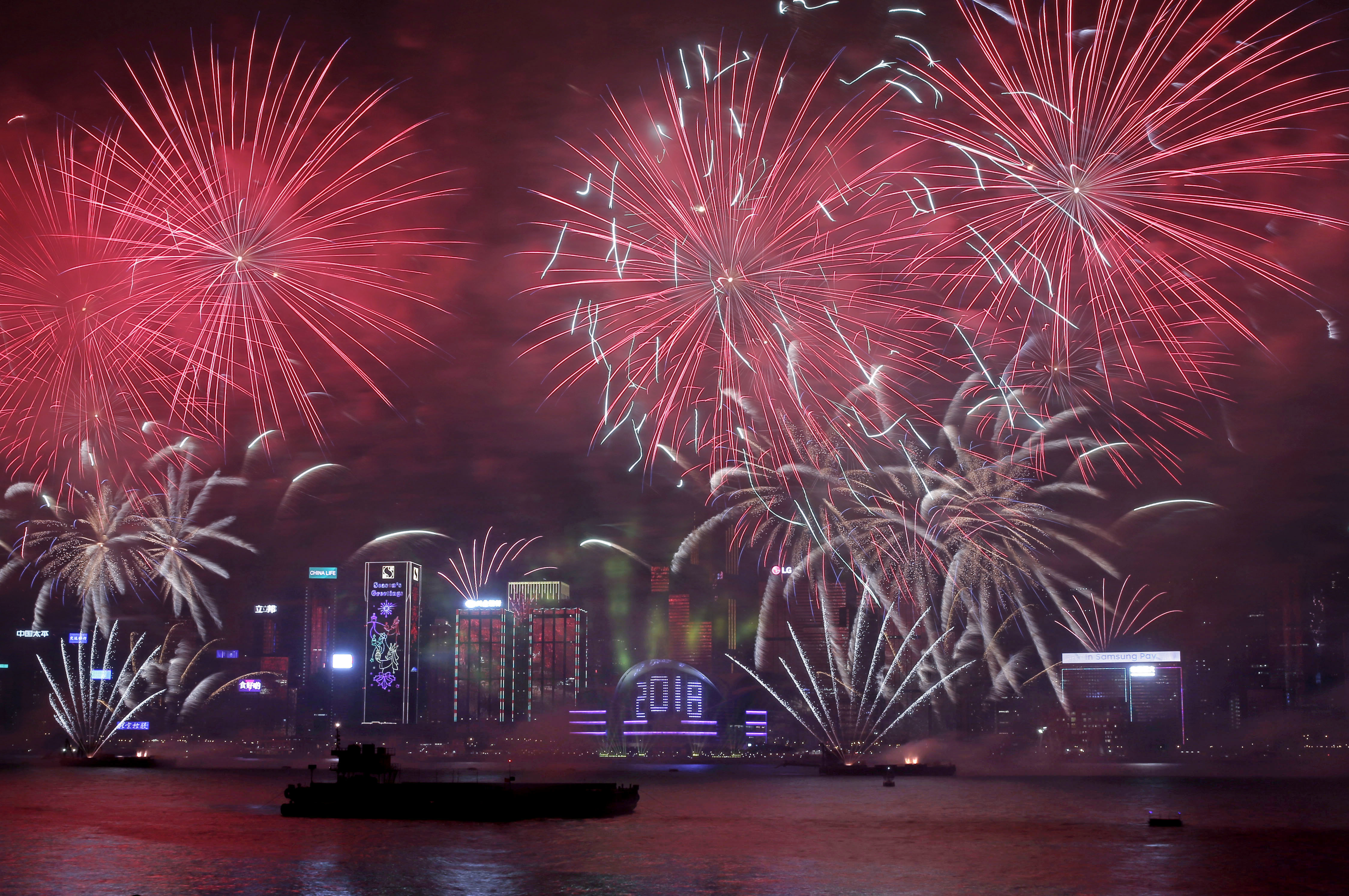 <div class='meta'><div class='origin-logo' data-origin='AP'></div><span class='caption-text' data-credit='AP Photo/Kin Cheung'>Fireworks explode over the Victoria Harbor during New Year's Eve to celebrate the start of year 2018 in Hong Kong, Monday, Jan. 1, 2018.</span></div>