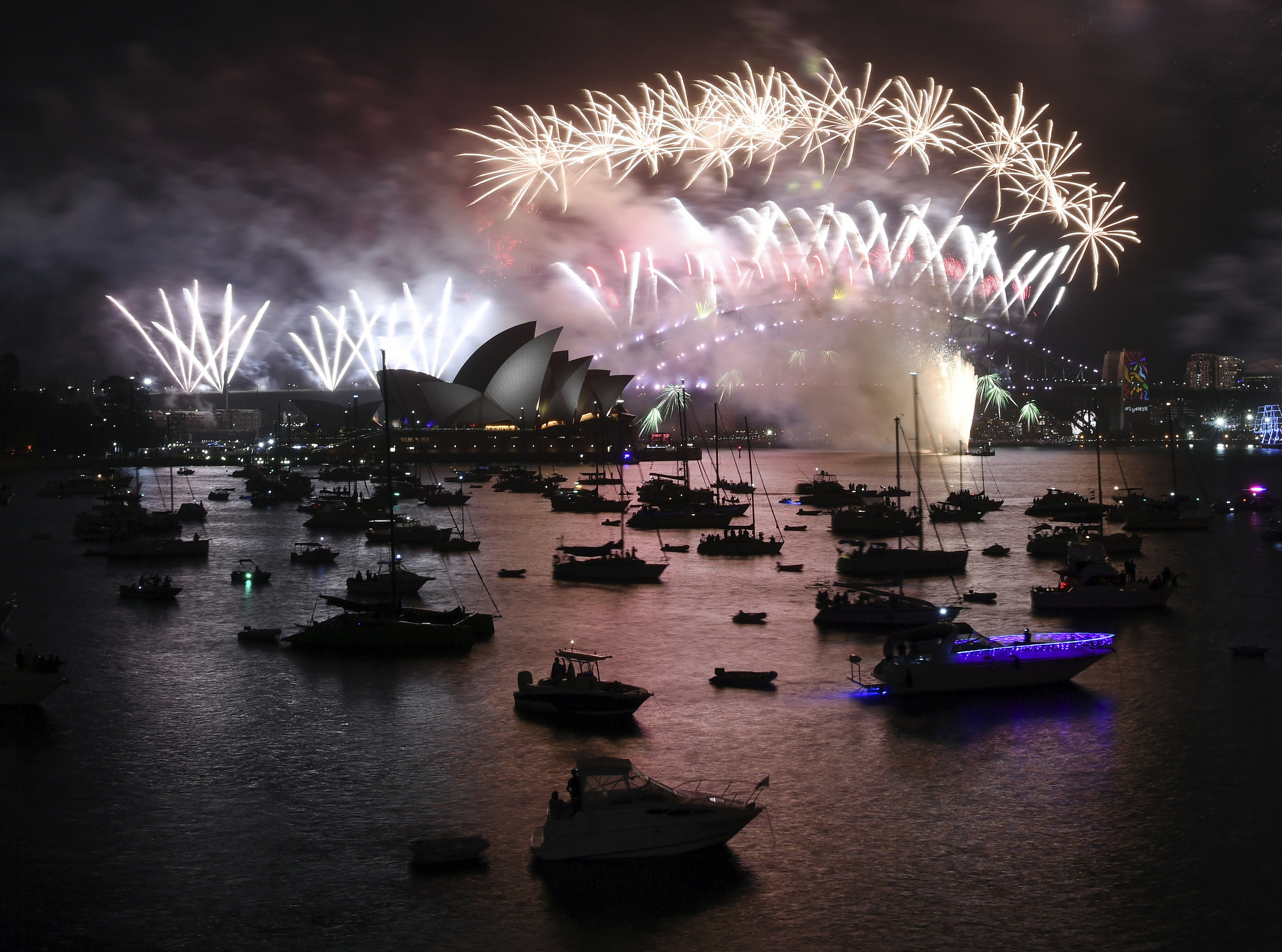 <div class='meta'><div class='origin-logo' data-origin='AP'></div><span class='caption-text' data-credit='David Moir/AAP Image via AP'>Fireworks explode over Sydney Harbour during New Year's Eve celebrations in Sydney, Monday, Jan. 1, 2018.</span></div>