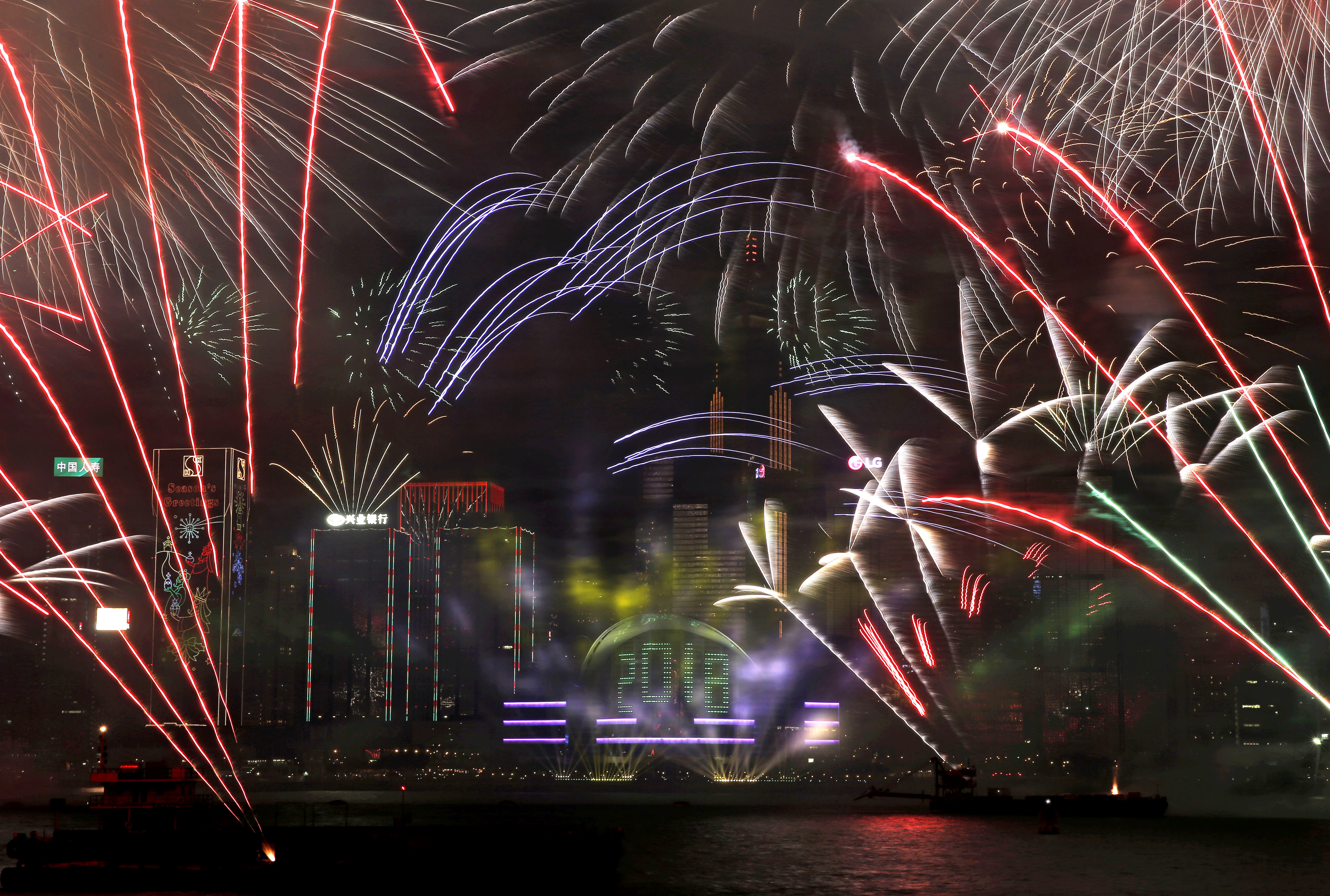 <div class='meta'><div class='origin-logo' data-origin='AP'></div><span class='caption-text' data-credit='AP'>Fireworks explode over the Victoria Harbor during New Year's Eve to celebrate the start of year 2018 in Hong Kong, Monday, Jan. 1, 2018. (AP Photo/Kin Cheung)</span></div>