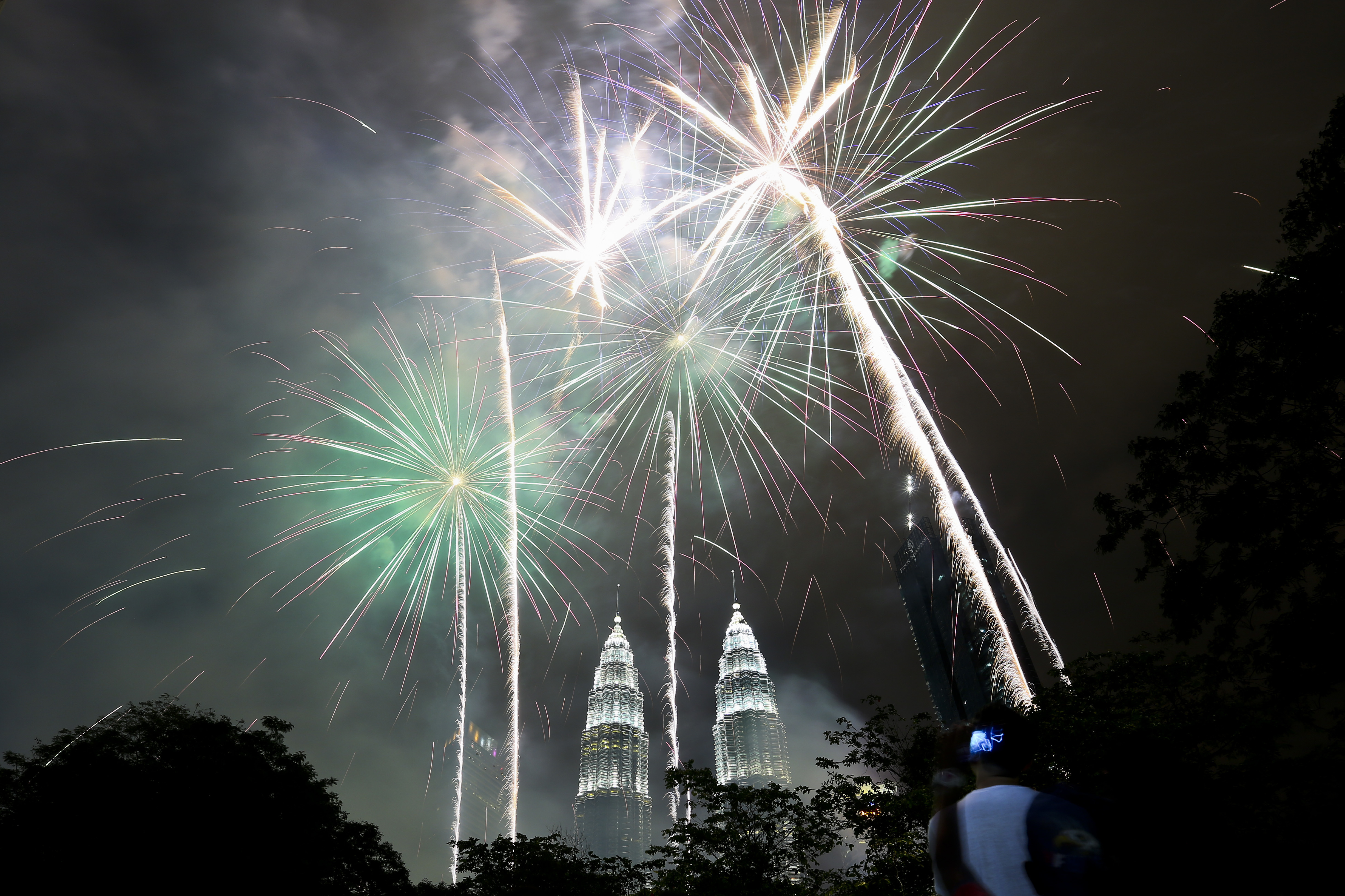 <div class='meta'><div class='origin-logo' data-origin='AP'></div><span class='caption-text' data-credit='AP Photo/Sadiq Asyraf'>Fireworks explode  in front of Malaysia's landmark building, the Petronas Twin Towers, during the New Year's celebration in Kuala Lumpur, Malaysia, Monday, Jan. 1, 2018.</span></div>