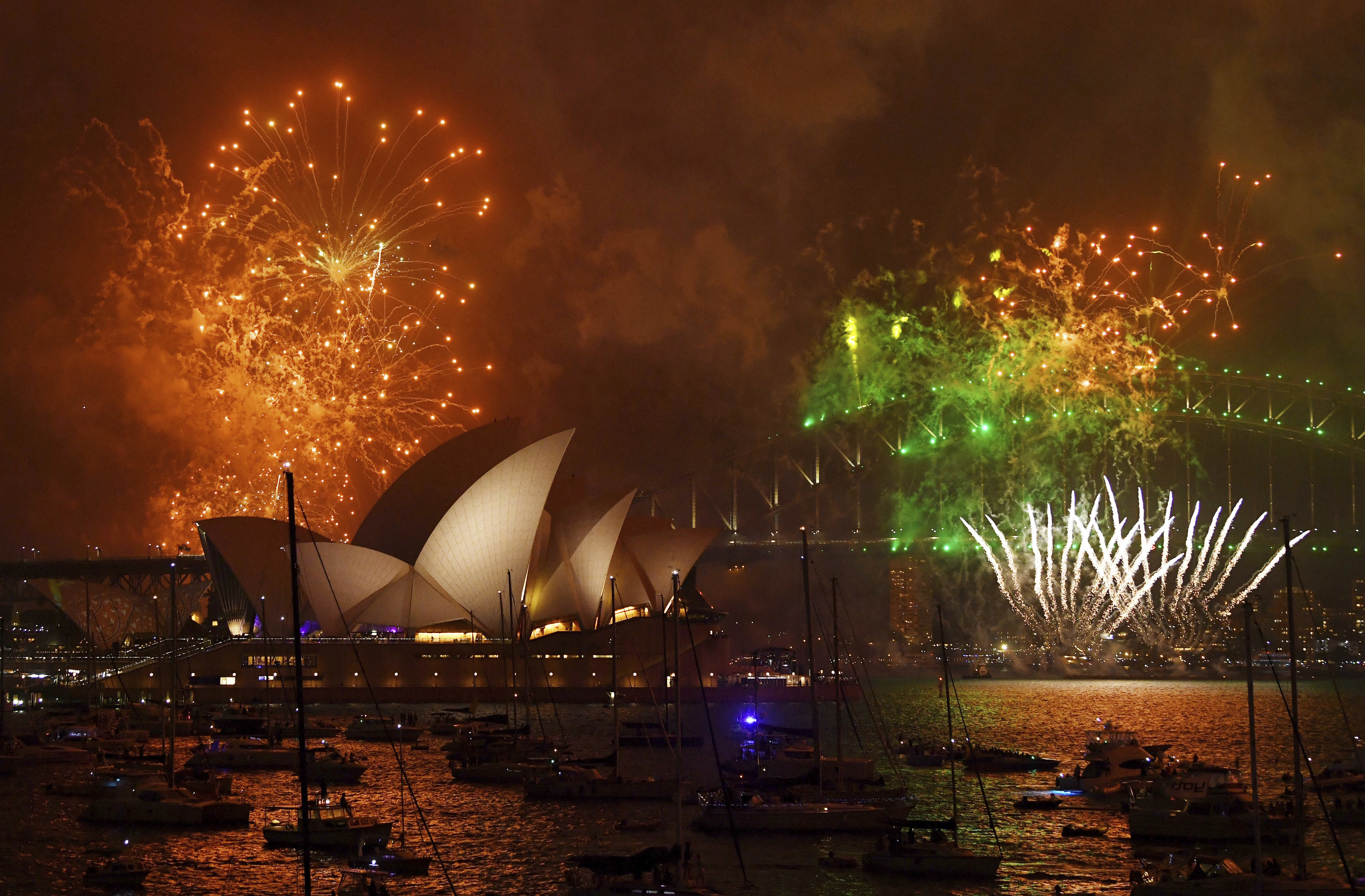 <div class='meta'><div class='origin-logo' data-origin='AP'></div><span class='caption-text' data-credit='David Moir/AAP Image via AP'>Fireworks explode over Sydney Harbour during New Year's Eve celebrations in Sydney, Australia, Sunday, Dec. 31, 2017.</span></div>