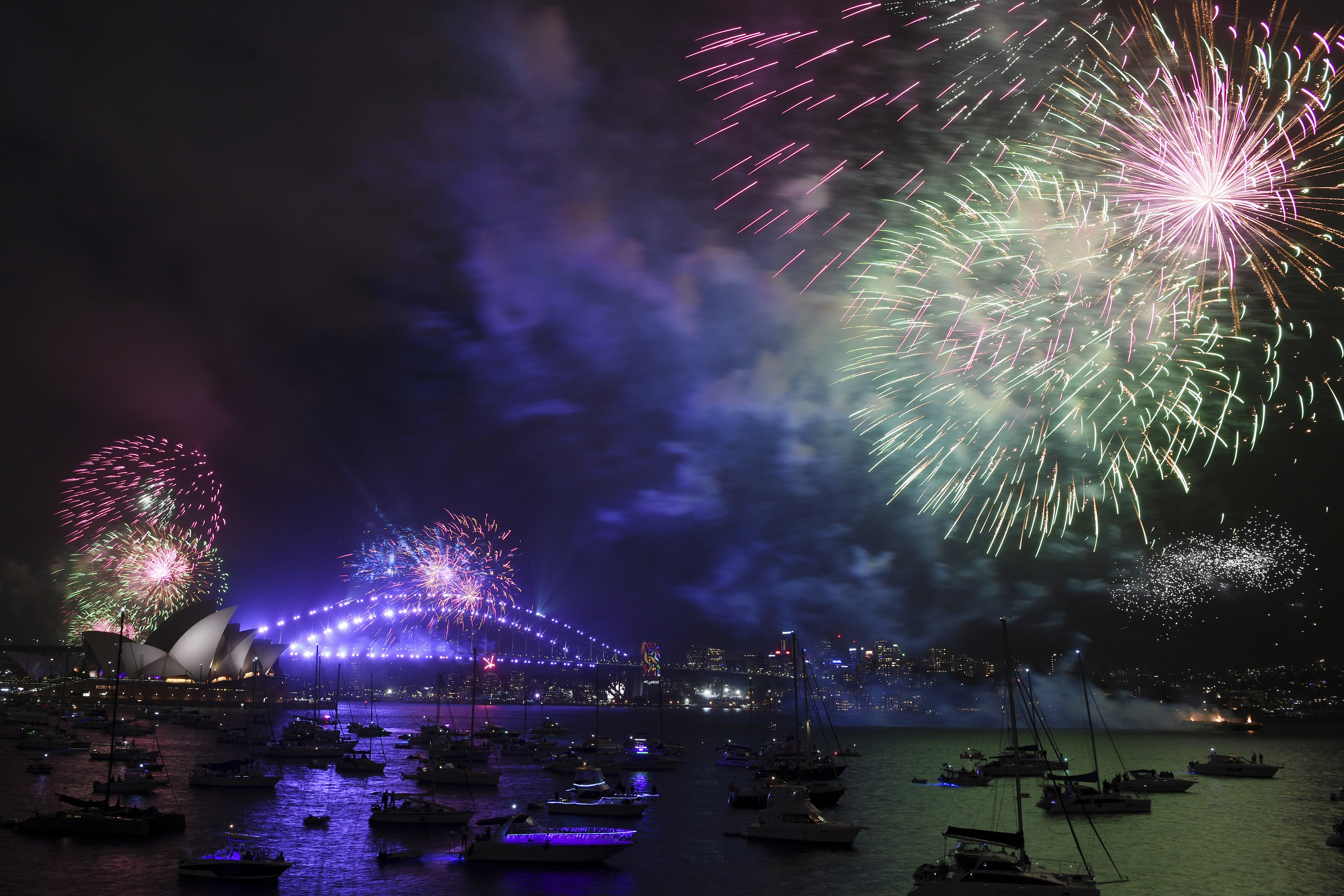 <div class='meta'><div class='origin-logo' data-origin='AP'></div><span class='caption-text' data-credit='David Moir/AAP Image via AP'>Fireworks explode over Sydney Harbour during New Year's Eve celebrations in Sydney, Sunday, Dec. 31, 2017.</span></div>