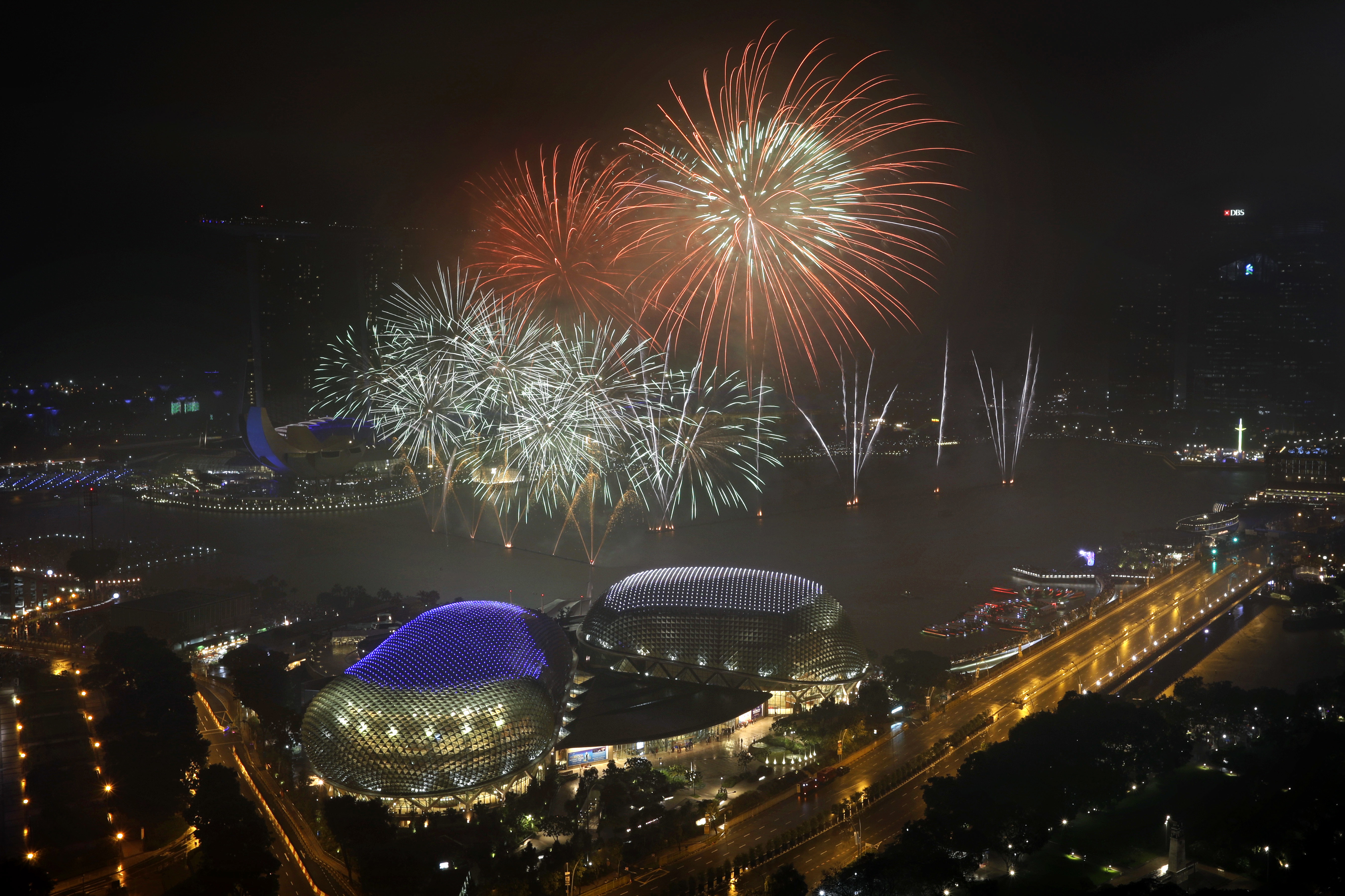 <div class='meta'><div class='origin-logo' data-origin='AP'></div><span class='caption-text' data-credit='AP Photo/Wong Maye-E'>Fireworks explode above Singapore's financial district at the stroke of midnight to mark the New Year's celebrations on Monday, Jan. 1, 2018, in Singapore.</span></div>