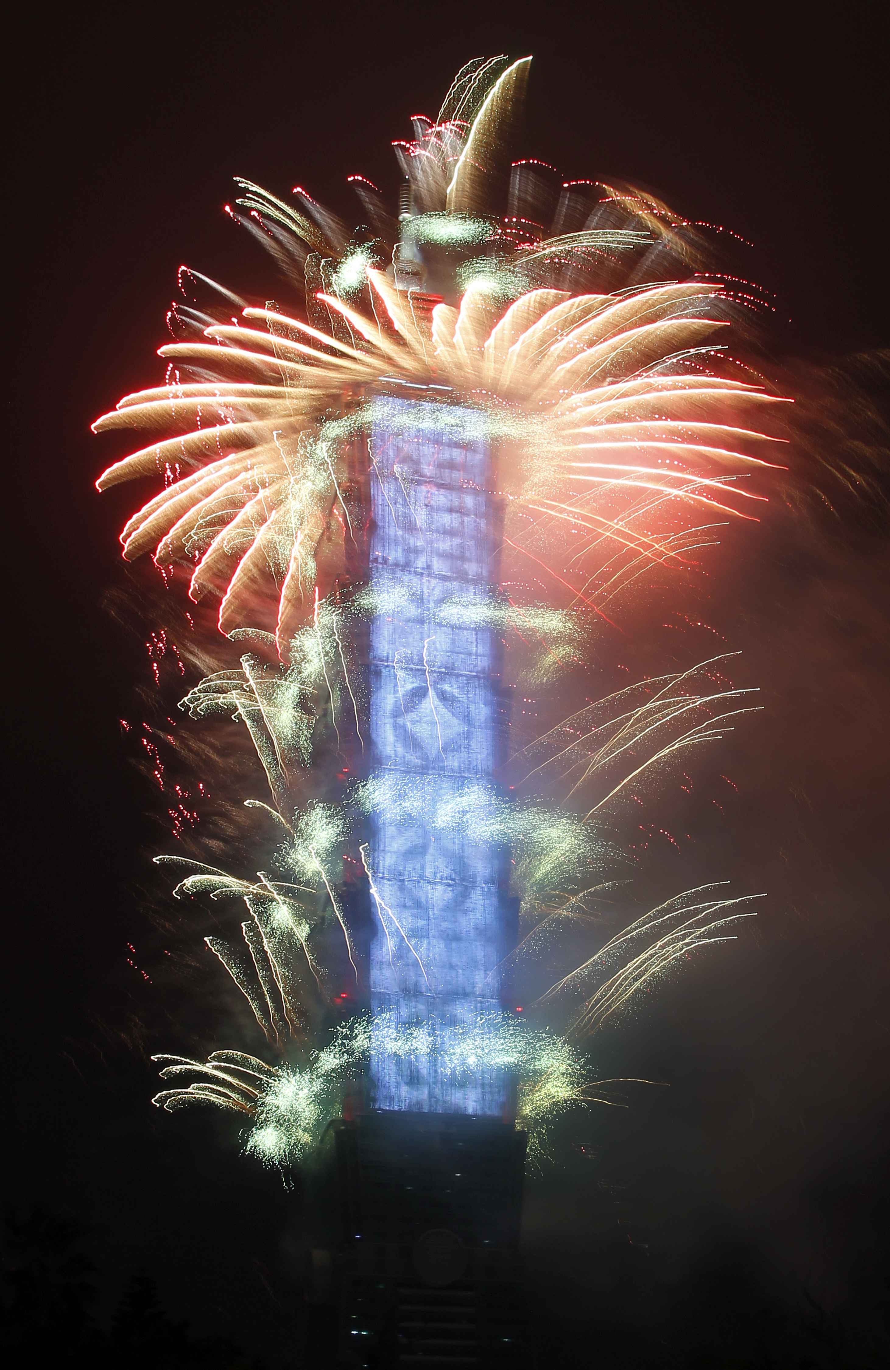 <div class='meta'><div class='origin-logo' data-origin='AP'></div><span class='caption-text' data-credit='AP Photo/Chiang Ying-ying'>Fireworks explode from the Taipei 101 building during the New Year's celebrations in Taipei, Taiwan, Monday, Jan. 1, 2018.</span></div>