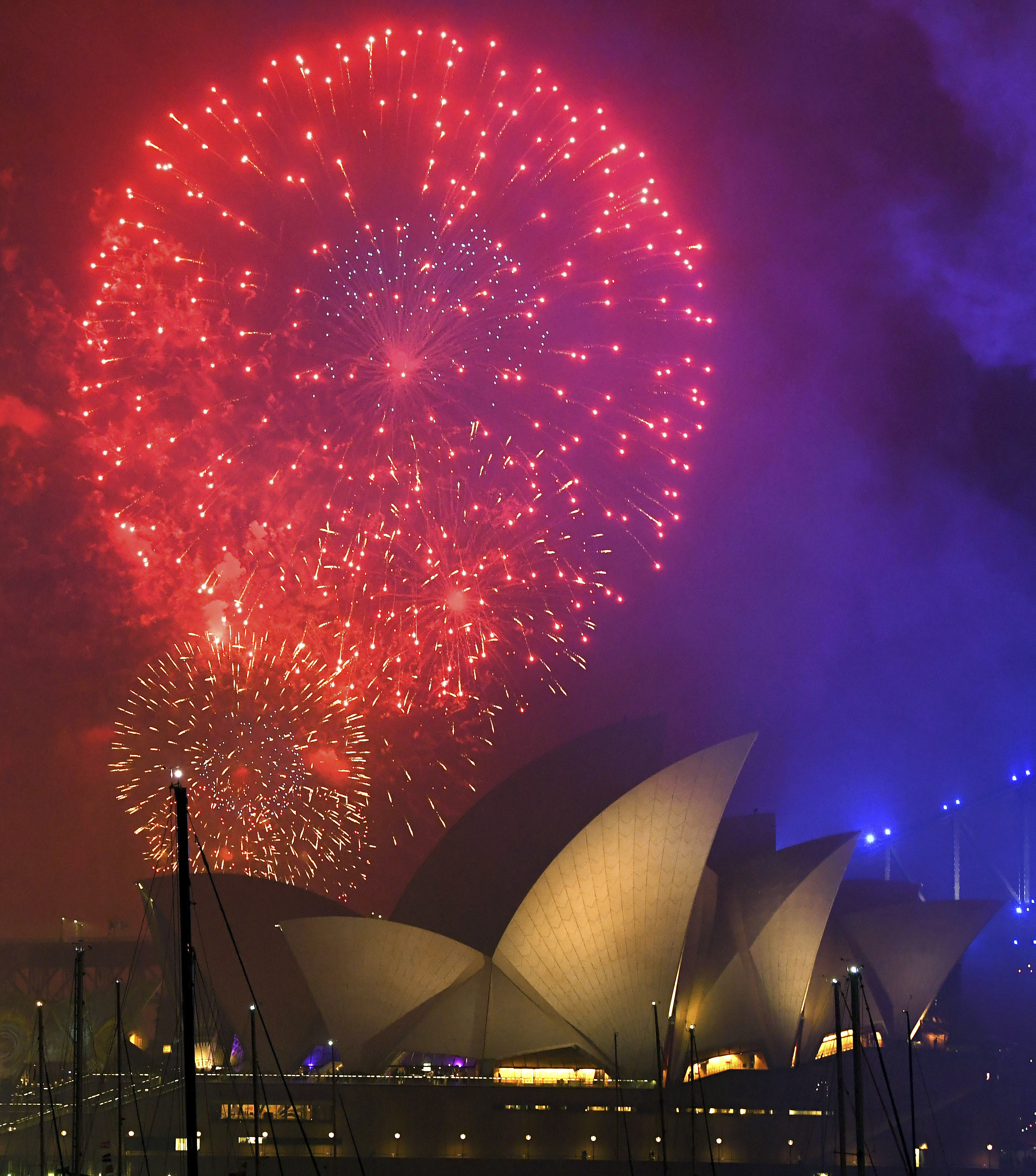 <div class='meta'><div class='origin-logo' data-origin='AP'></div><span class='caption-text' data-credit='David Moir/AAP Image via AP'>Fireworks explode over the Opera House during New Year's Eve celebrations in Sydney, Australia, Sunday, Dec. 31, 2017.</span></div>