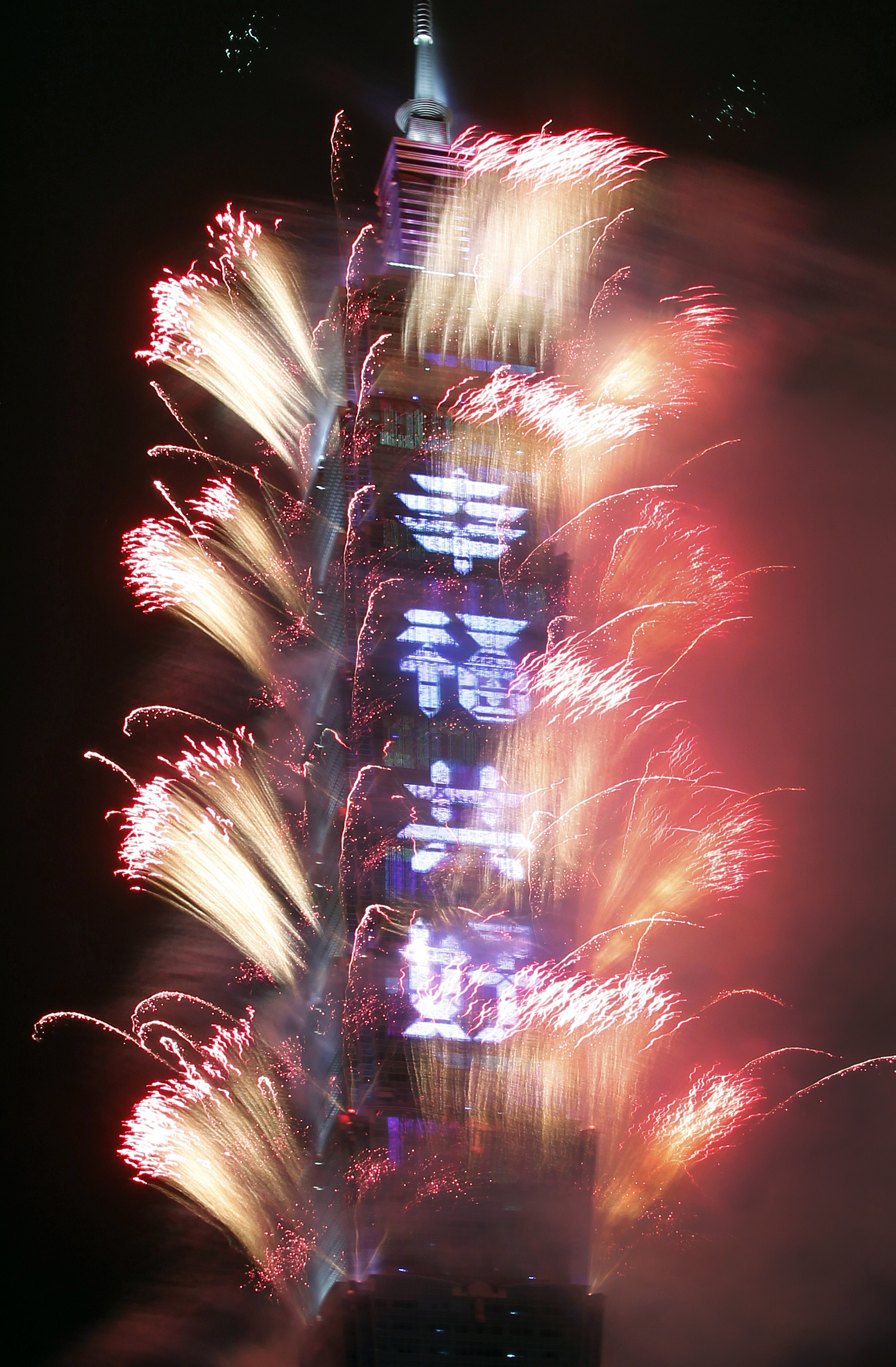 <div class='meta'><div class='origin-logo' data-origin='AP'></div><span class='caption-text' data-credit='AP Photo/Chiang Ying-ying'>Fireworks explode with slogan reading &#34;Happiness and Good Condition Together&#34; on the Taipei 101 building during the New Year's celebrations in Taipei, Taiwan, Monday, Jan. 1, 2018.</span></div>