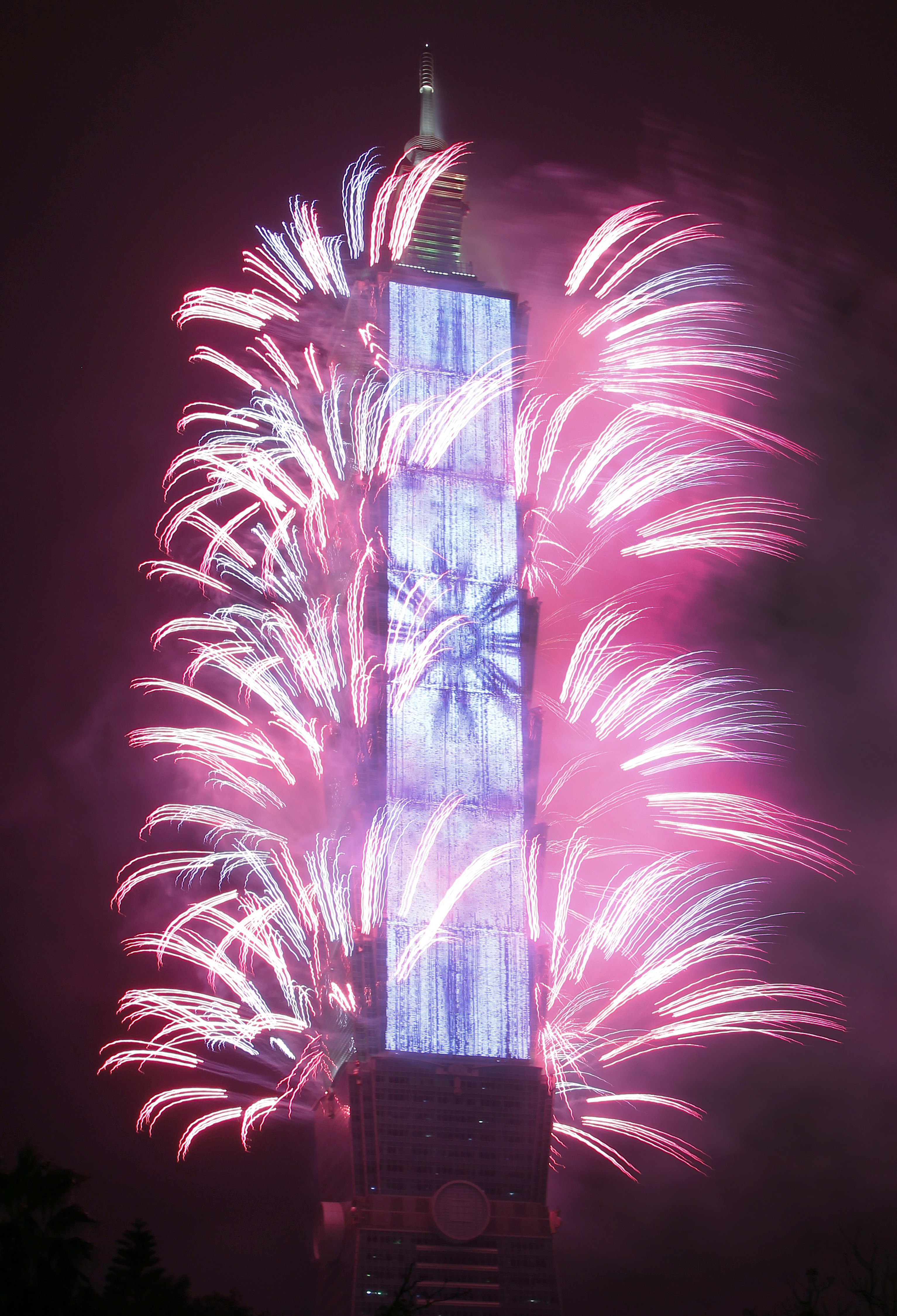 <div class='meta'><div class='origin-logo' data-origin='AP'></div><span class='caption-text' data-credit='AP'>Fireworks explode from the Taipei 101 building during the New Year's celebrations in Taipei, Taiwan, Monday, Jan. 1, 2018. (AP Photo/Chiang Ying-ying)</span></div>