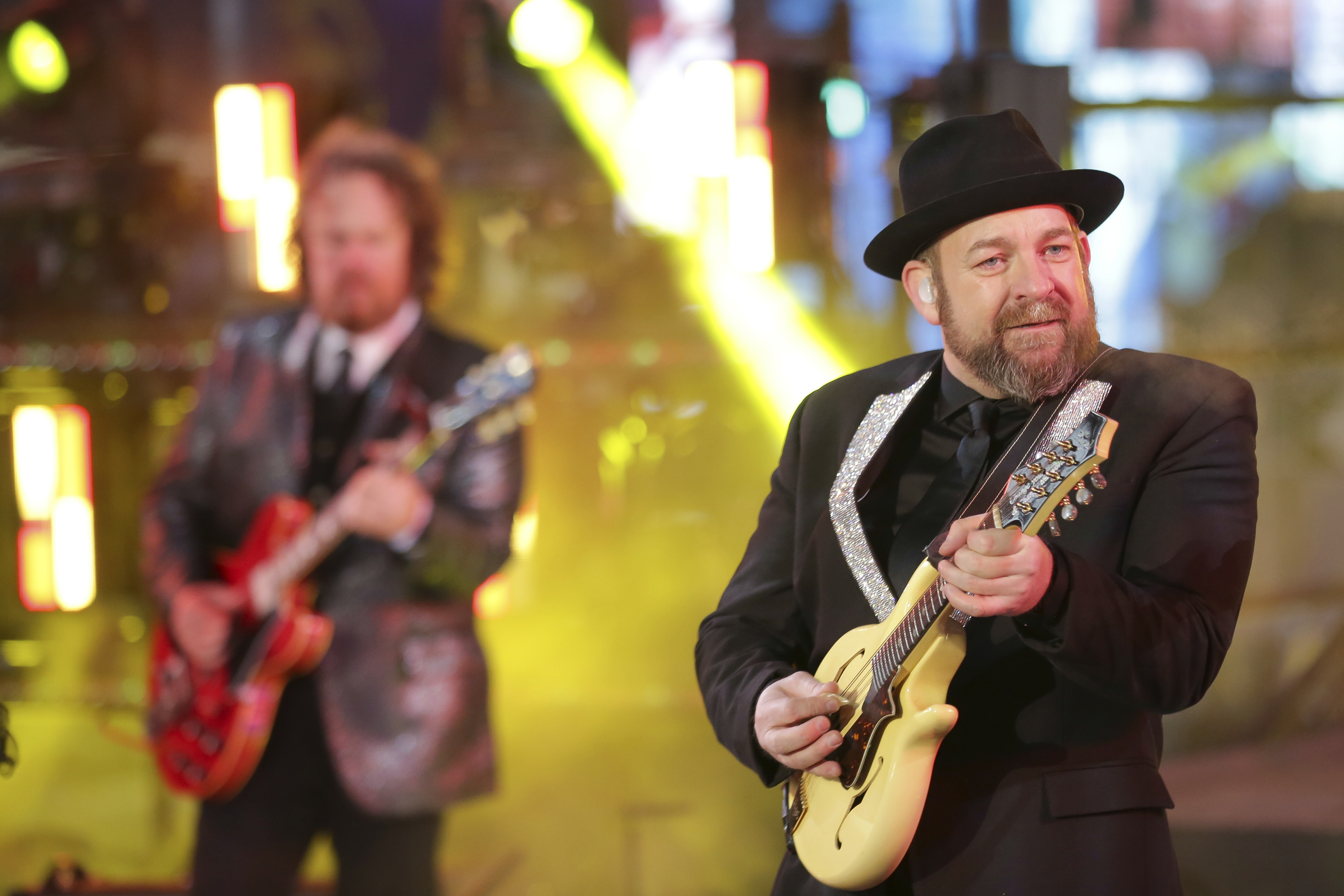 "<div class=""meta image-caption""><div class=""origin-logo origin-image ap""><span>AP</span></div><span class=""caption-text"">Kristian Bush, right, of Sugarland, performs on stage at the New Year's Eve celebration in Times Square on Sunday, Dec. 31, 2017, in New York. ) (Brent N. Clarke/Invision/AP)</span></div>"