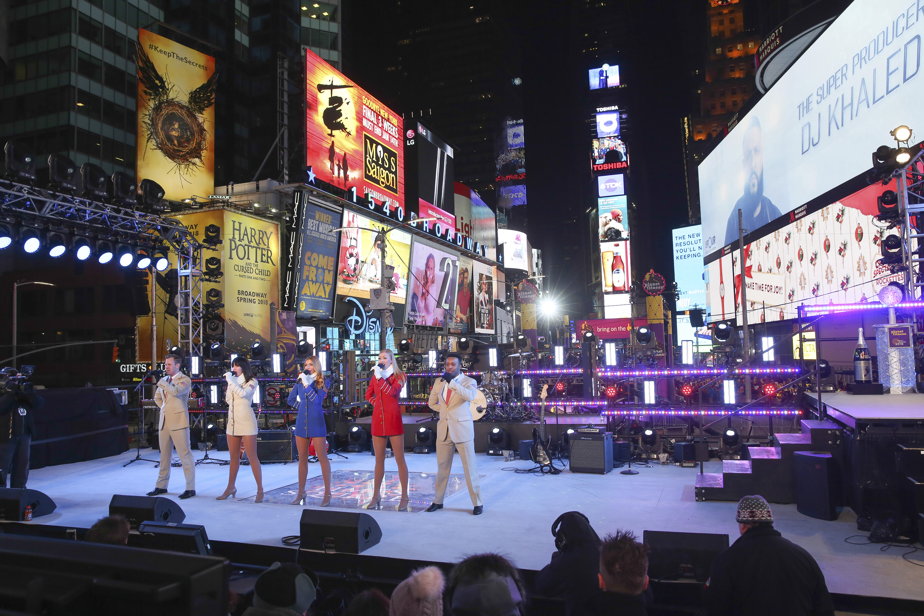 <div class='meta'><div class='origin-logo' data-origin='AP'></div><span class='caption-text' data-credit='Brent N. Clarke/Invision/AP'>The USO Troupe performs at the New Year's Eve celebration in Times Square on Sunday, Dec. 31, 2017, in New York. (Photo by Brent N. Clarke/Invision/AP)</span></div>
