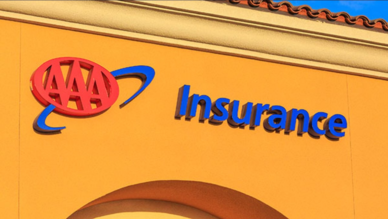 FRESNO, CA, USA - DEC 19, 2017 - Business logo sign on the wall of store front of AAA Insurance