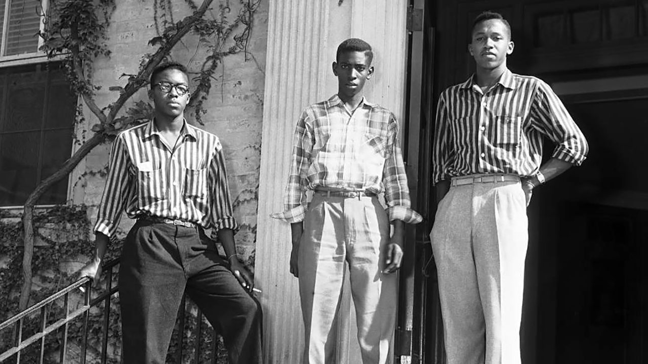 From left, Leroy Frasier, John Lewis Brandon, and Ralph Frasier, are seen on the steps of South Building, 1955.