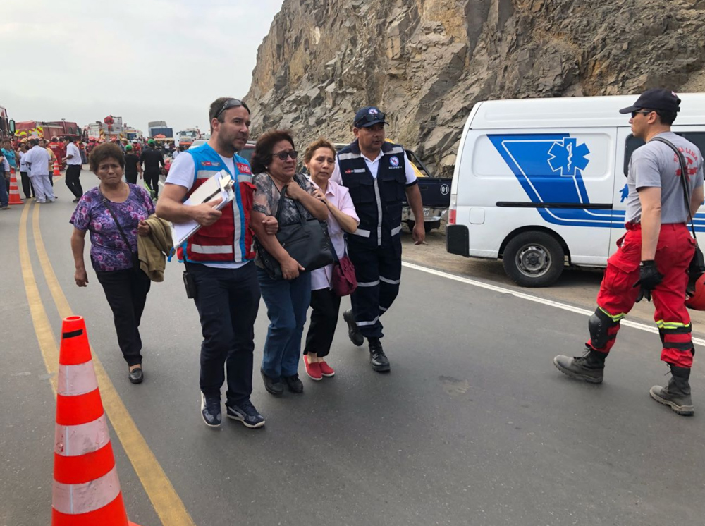 "<div class=""meta image-caption""><div class=""origin-logo origin-image none""><span>none</span></div><span class=""caption-text"">Dozens of passengers have been reported dead from a bus that fell off a cliff after it was hit by a tractor-trailer rig in Pasamayo, Peru. (@Minsa_Peru/Twitter)</span></div>"
