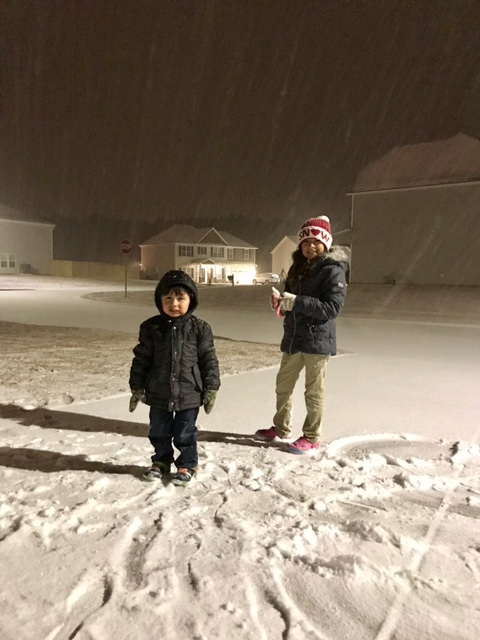 "<div class=""meta image-caption""><div class=""origin-logo origin-image none""><span>none</span></div><span class=""caption-text"">Under the snow fall. Ayden and Analise Lopez. Cumberland County. (Lissett Lopez - ABC11 Eyewitness)</span></div>"