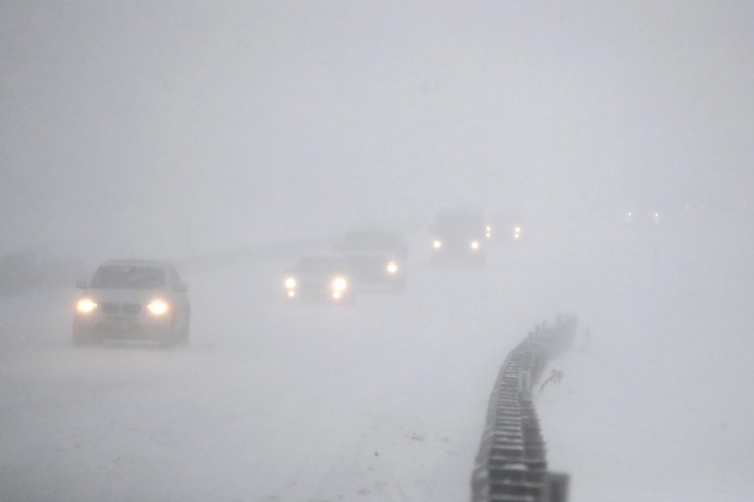 <div class='meta'><div class='origin-logo' data-origin='AP'></div><span class='caption-text' data-credit='AP Photo/Julio Cortez'>Vehicles commute southbound on the Garden State Parkway in whiteout conditions during a snowstorm, Thursday, Jan. 4, 2018, in Eatontown, N.J.</span></div>