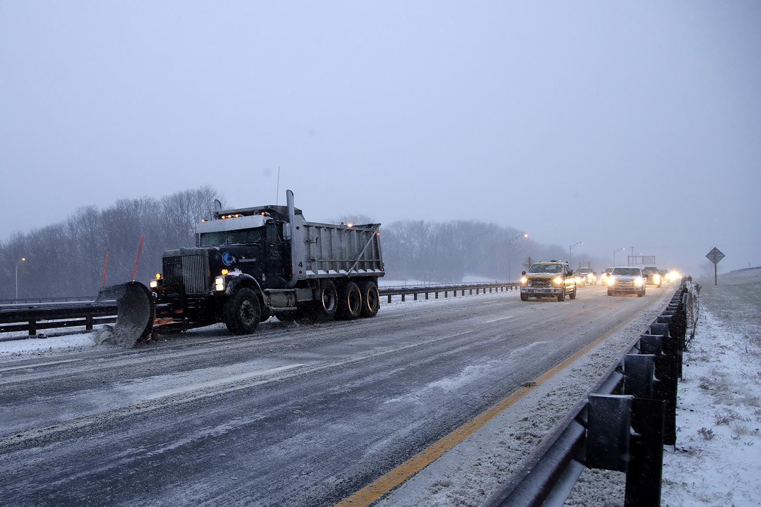 <div class='meta'><div class='origin-logo' data-origin='AP'></div><span class='caption-text' data-credit='AP Photo/Julio Cortez'>Traffic follows behind a plow clearing snow off the Garden State Parkway during a snowstorm, Thursday, Jan. 4, 2018, in South Amboy, N.J.</span></div>