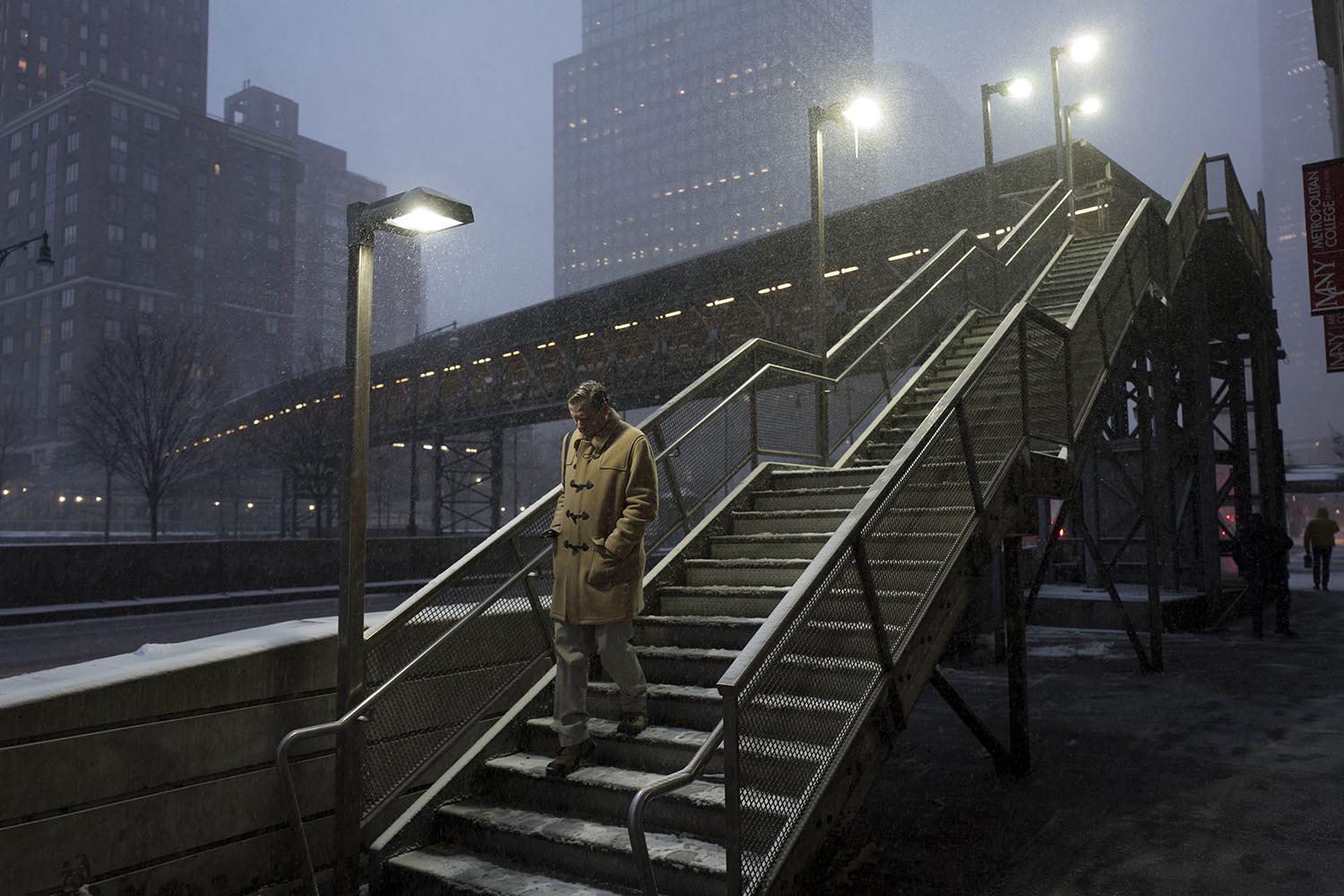 "<div class=""meta image-caption""><div class=""origin-logo origin-image ap""><span>AP</span></div><span class=""caption-text"">A man walks down a staircase through an early morning snowfall, Thursday, Jan. 4, 2018, in New York. (AP Photo/Mark Lennihan)</span></div>"